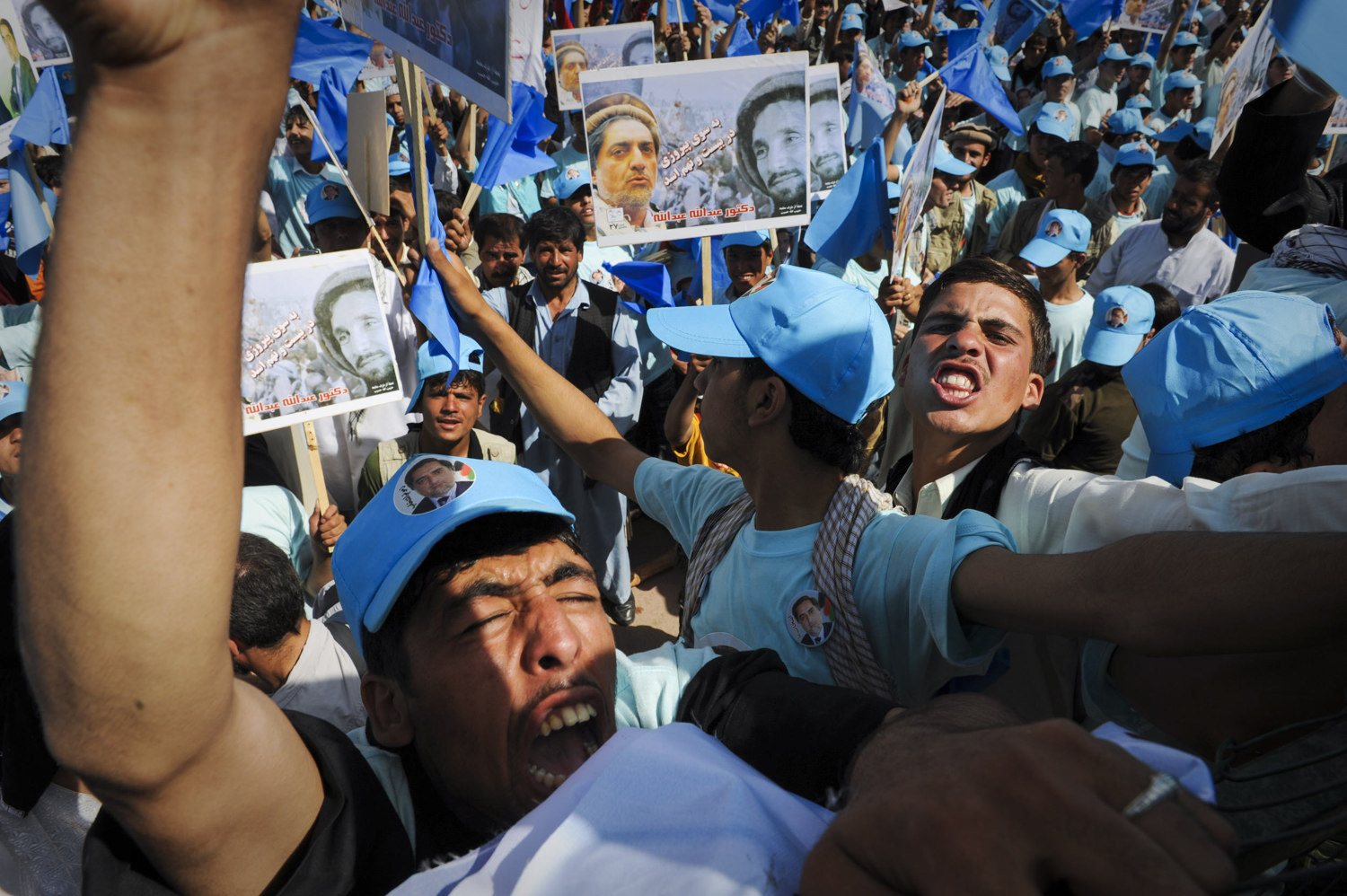 Afghan youth supporters of Dr. Abdullah Abdullah at a political rally at the Kabul Stadium in Kabul Afghanistan on August 17th, 2009. the country later went on to elect incumbent president Hamid Karzai after months of debate over a tampered election.
