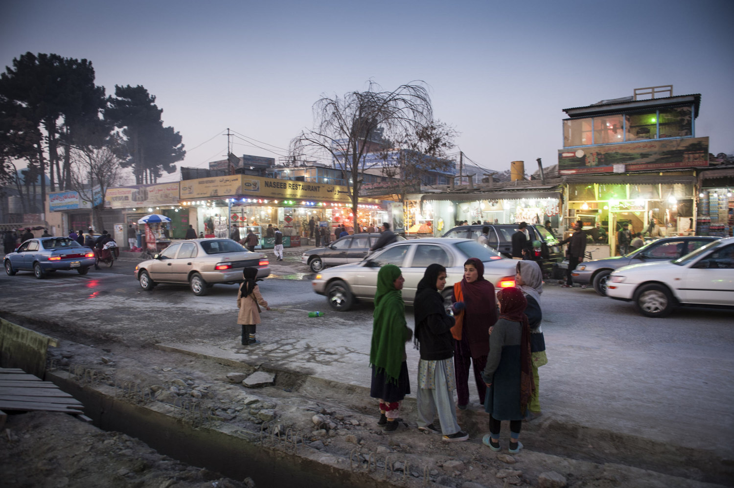 Girls on the street in the upscale Shar-e-now section of Kabul. There are many restaurants in the area featuring separate seating sections for men and women.