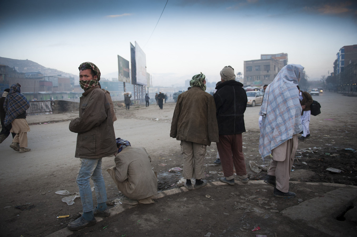 Day laborers wait outside the Pashto Market in downtown Kabul hoping to be chosen to work for the day. Workers make 250 Afghans (3-5 dollars) a day and often come from provinces in Afghanistan to seek out  the unregulated labor market and often live in squalid conditions in order to send more money home.