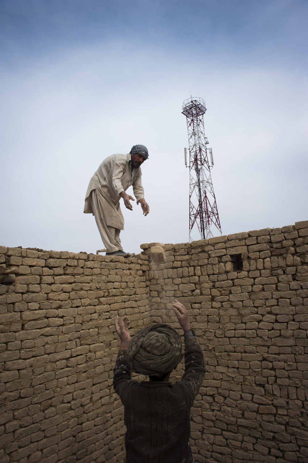 Day Laborer's chosen to build a wall in Kabul Afghanistan. Workers make 250 Afghans (3-5 dollars) a day and often come from provinces in Afghanistan to seek out  the unregulated labor market and often live in squalid conditions in order to send more money home.