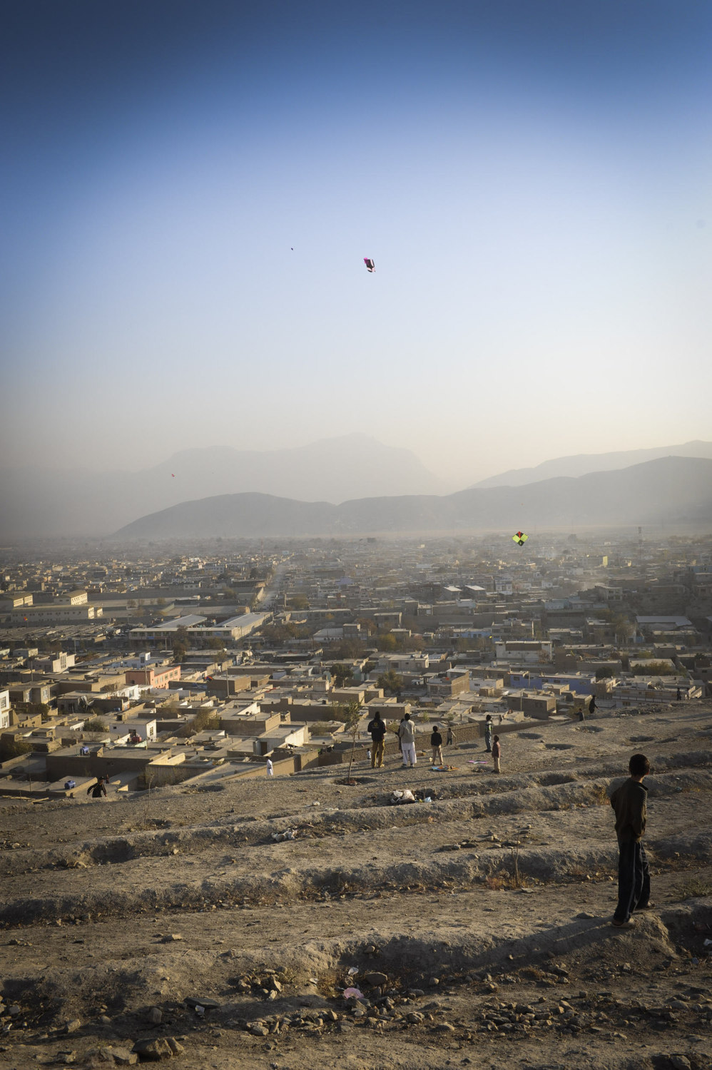 Afghans gather on a Friday on Nadir Shah Hill, or Kite Hill- to fly paper kites and battle others in a traditional match. When a Kite is cut children with long brooms have to catch the kites before their prize blows away. Kite flying is a popular recreation for Afghan children