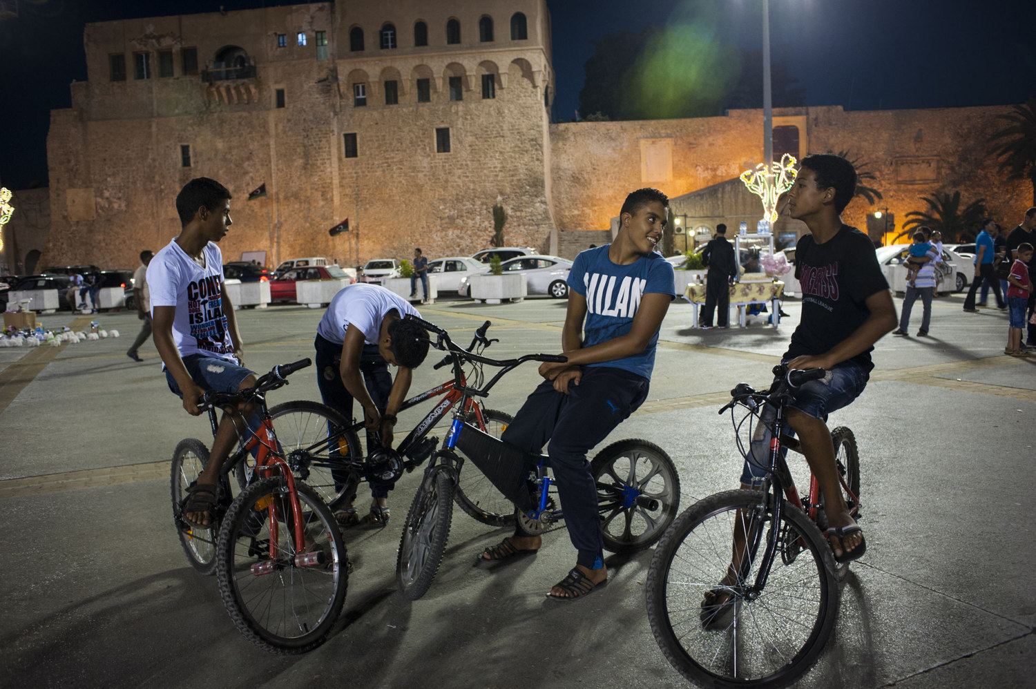Young boys on bikes in Martyr Square in Tripoli, Libya. 42 years after the reign of Col. Muammar Gaddafi and a violent civil war Libya is waking up to a new and free country. With civil services and the countries infrastructure in ruins Libyans struggle with the transition period from dictatorship to democracy.