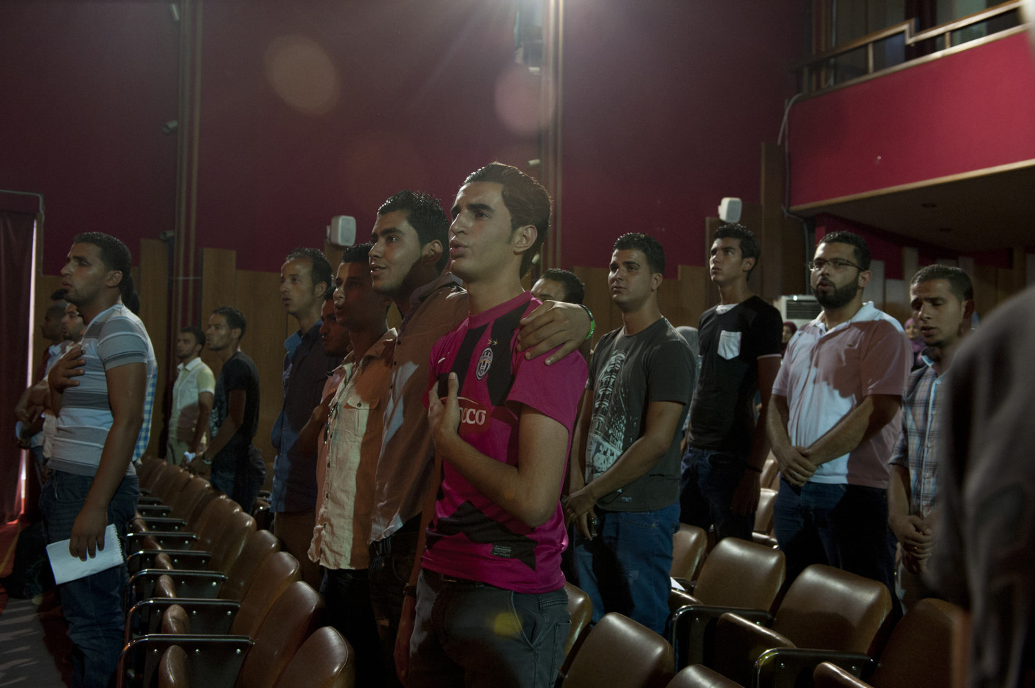 Students at Tripoli University sing the national anthem and attend a meeting of the elected Student Council on July 12th 2012.