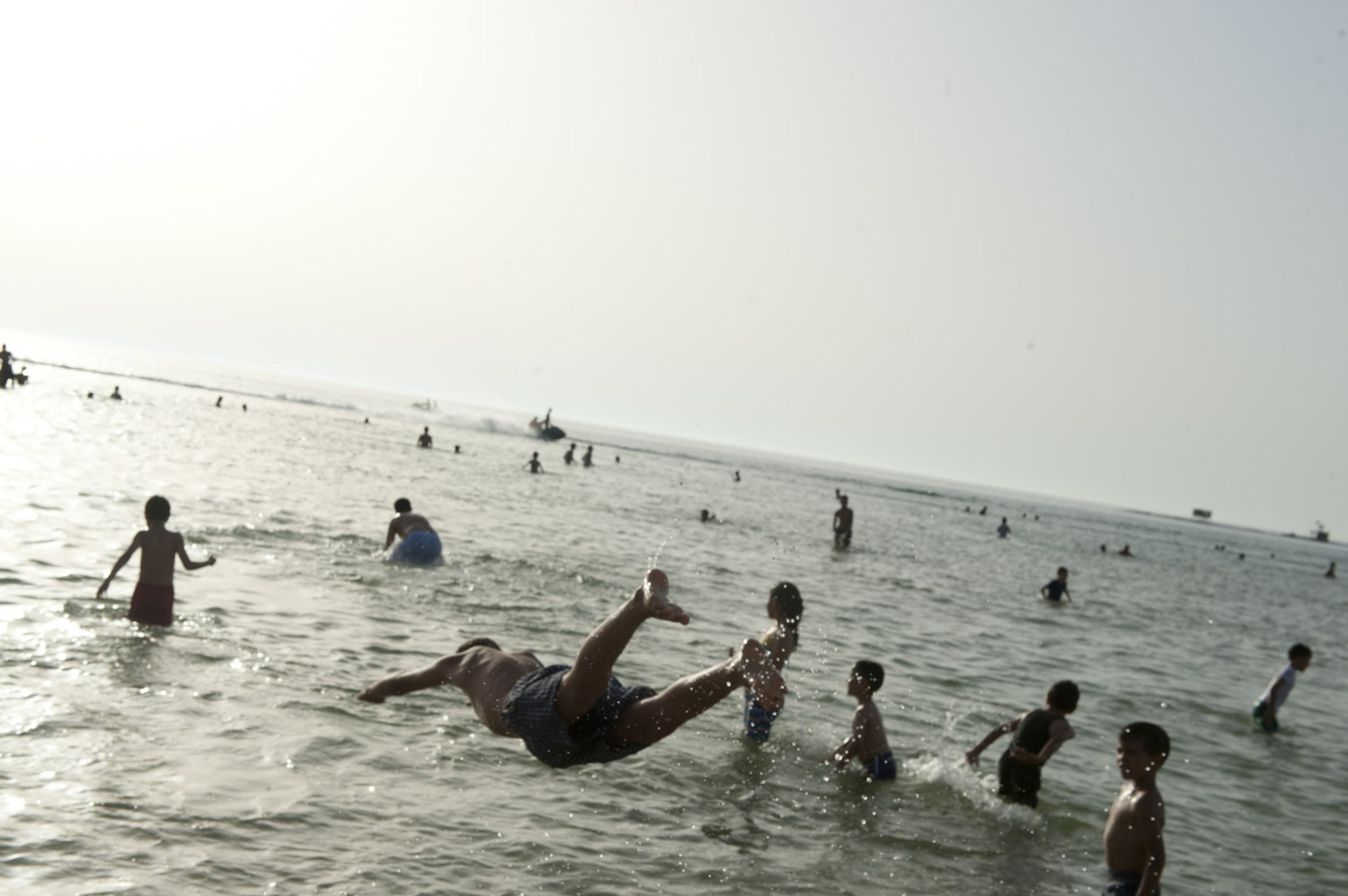 Boys escape the summer heat by diving into the ocean in downtown Tripoli on July 1st, 2012.