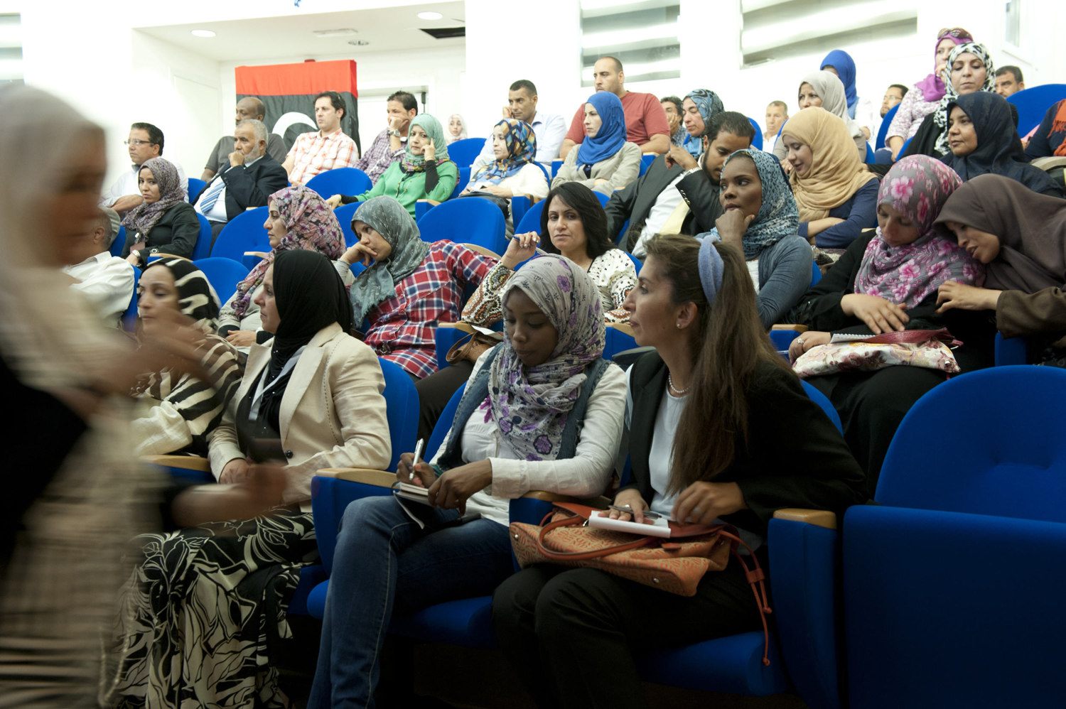 Women take notes during the Libyan International Women's Organization meeting in Tripoli on July 11th, 2012.