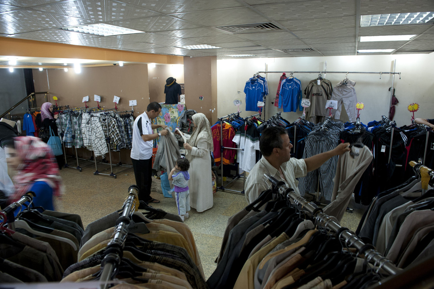 A family shops for clothing in a shopping mall in Souq Al-Jum'a in Tripoli on July 10th 2010.