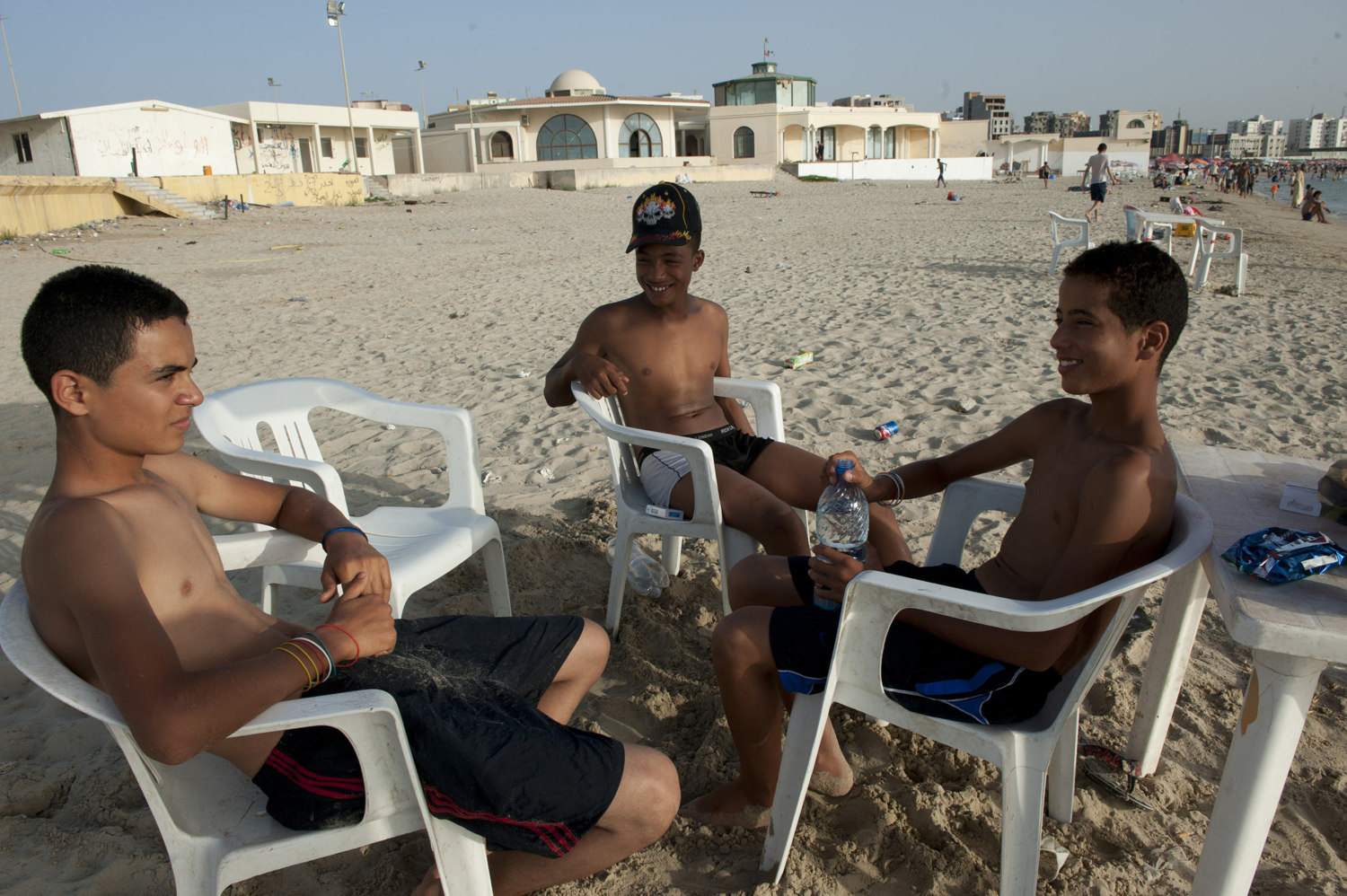 Boys escape the summer heat by going to the ocean in downtown Tripoli on July 1th, 2012