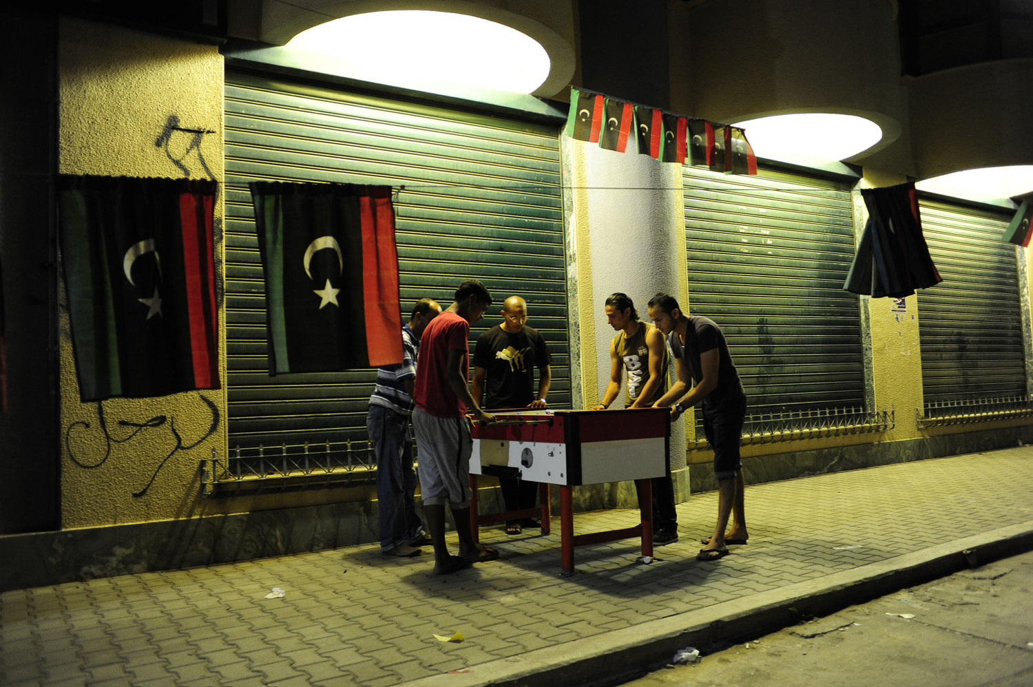 A group of men play table football of the country's first election since the end of the Gaddafi rule, July 6th, 2012. After 42 years of Muammar Gaddafi's reign, Libyans are participating in the first democratic election since 1969.
