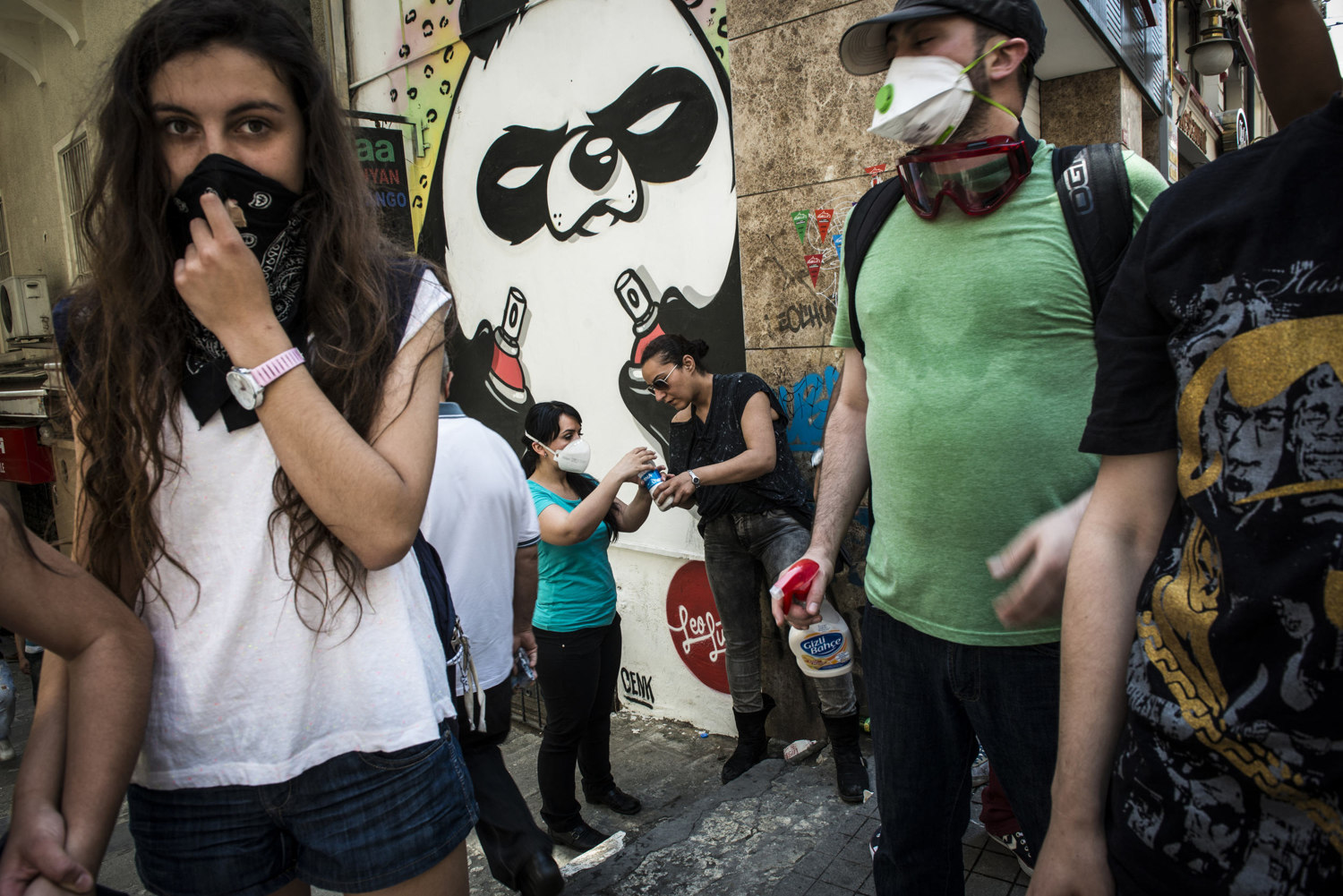 Students prepare a solution of water and milk as an a deterrent for the sting of tear gas off of Istiklal Cadessi on  June 1, 2013