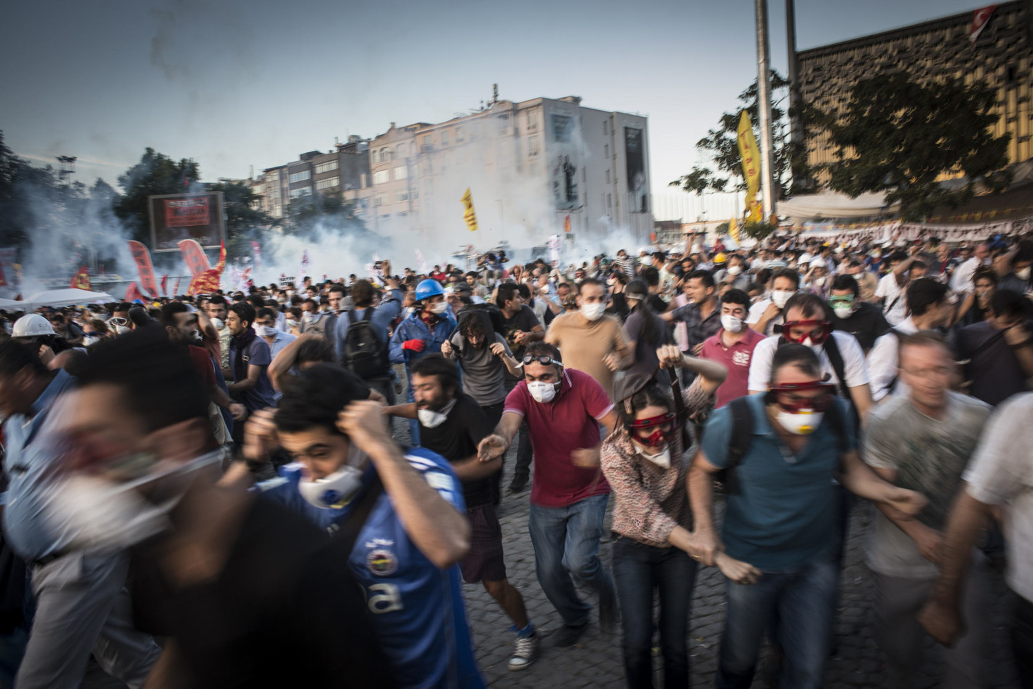 As clashes turn violent, demonstrators run from the police. 