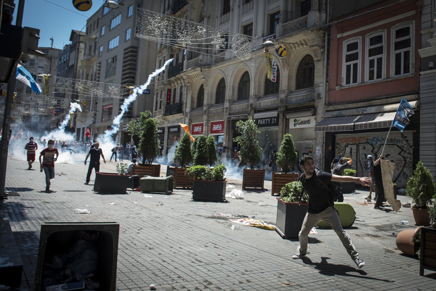 On one of the first days of the protest June 1 2013, demonstrators throw rocks and molotov cocktails at the police on the busy shopping street known as Istiklal Cadessi, in Istanbul Turkey.