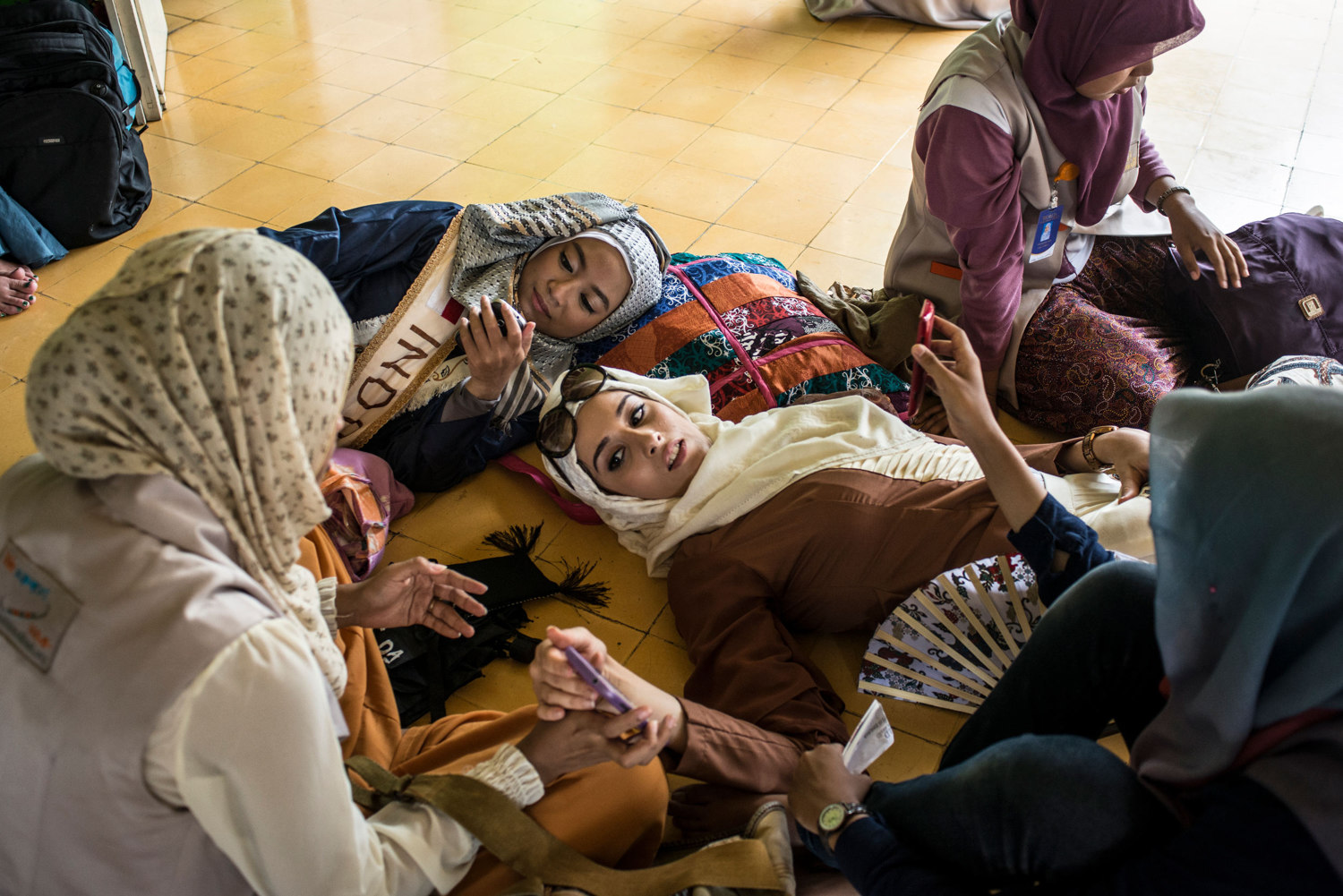 Fatma Ben Guefrache, the finalist from Tunisia and one of the Indonesian finalists rest after praying at a mosque.