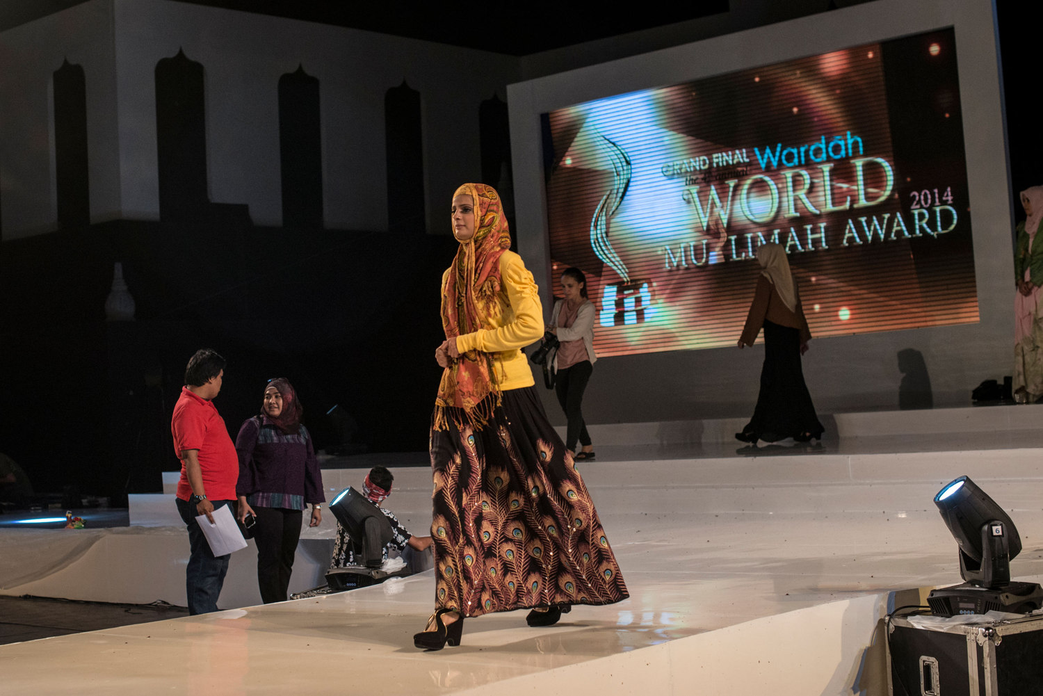 The finalists are given their shoes and begin rehearsals for the Grand Finale on November 20th, 2014 in Yogakarta, Indonesia. Pictured walking is Nazreen Ali.