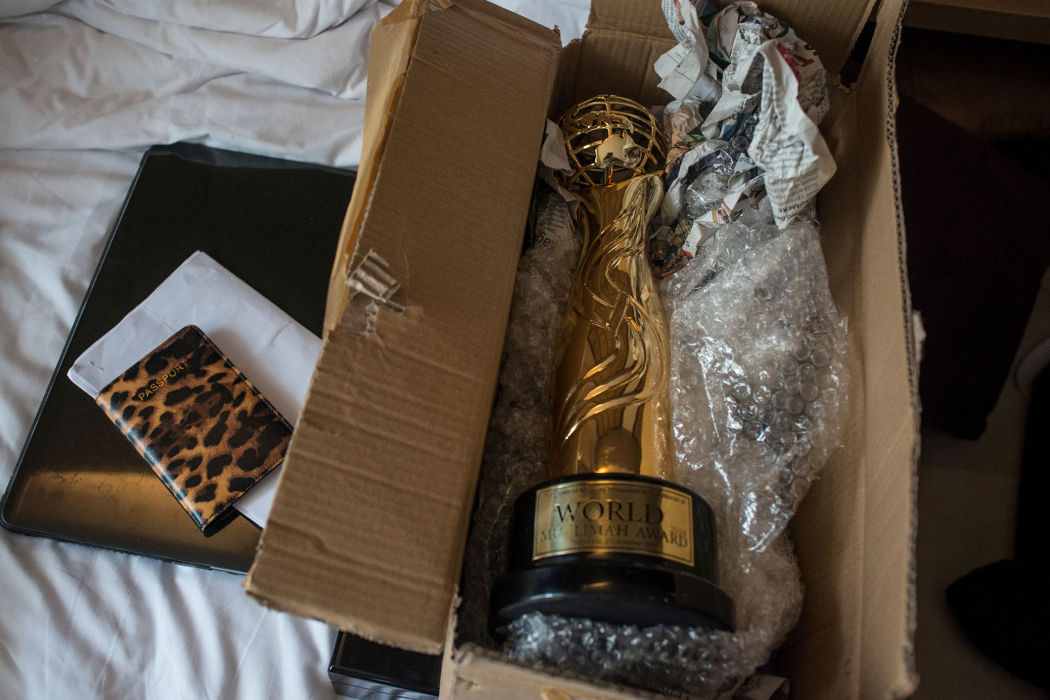 The Miss Muslimah 2014 trophy sits on Fatma Ben Guefrache of Tunisia's bed as she packs to leave Indonesia.