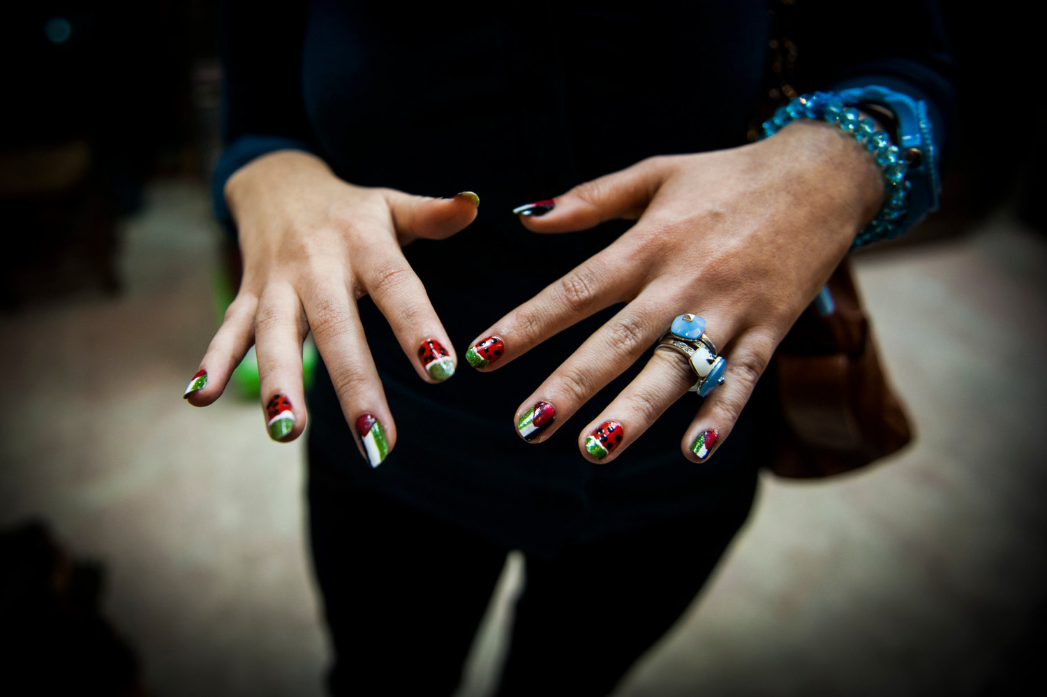 A girl shows off her Palestinian themed nails after a recent bombing campaign.