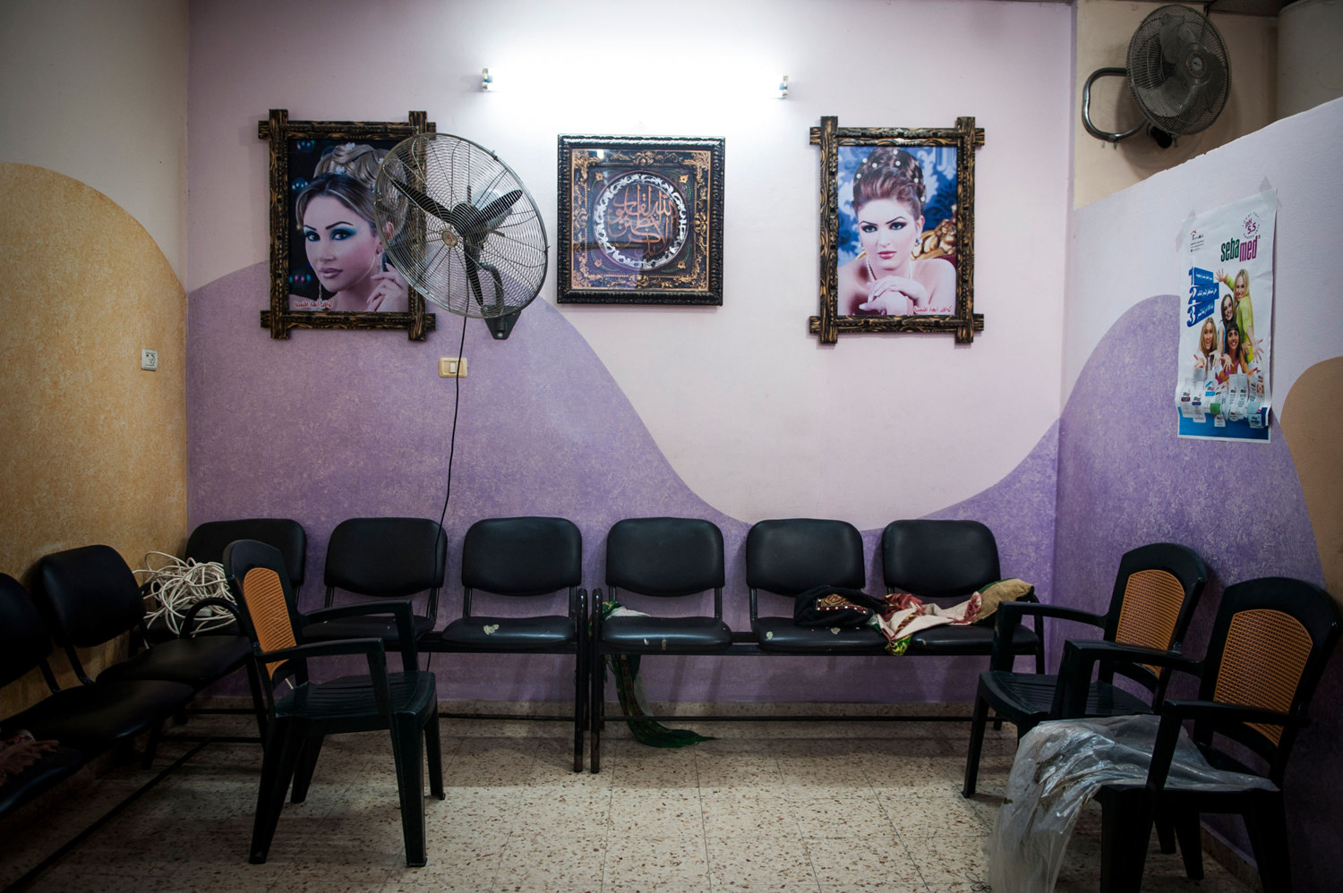 At a salon in Gaza City women come to get their hair, nails, and makeup done before weddings. In many families, a woman is not allowed to be seen without a veil by a man outside of her family, so beauty salons are for women only.