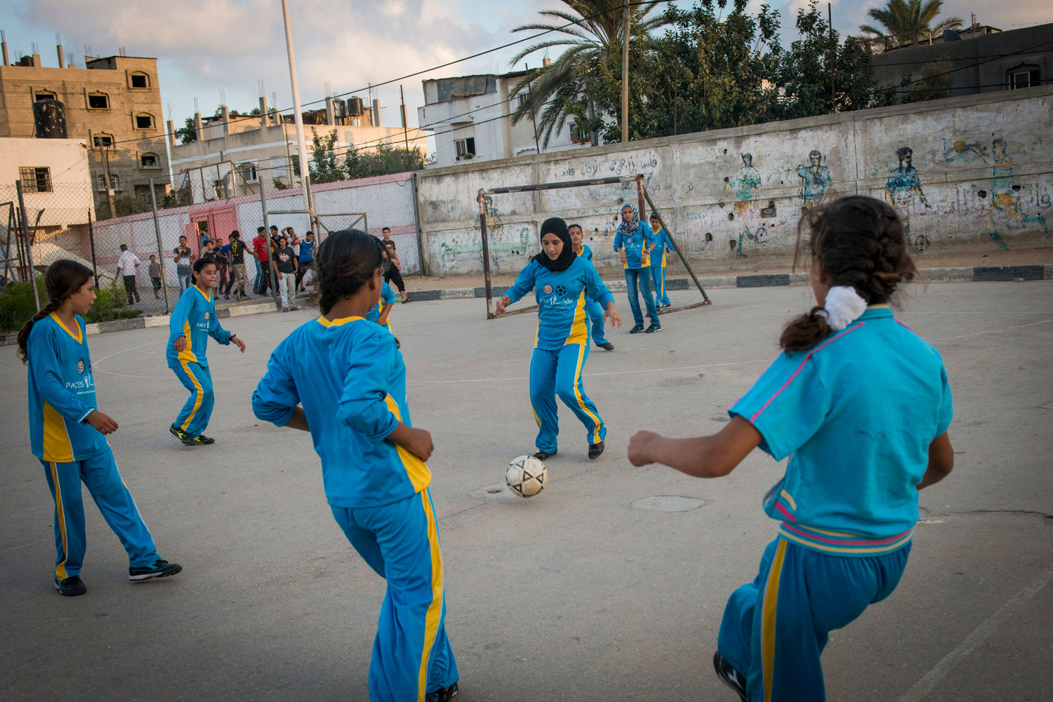 Girls play football in the Northern Gaza town of Beit Lahiyah. Women in Gaza typically do all types of sports till the age of 16, when family pressure forces them to stop as many families seek to find husbands for them.