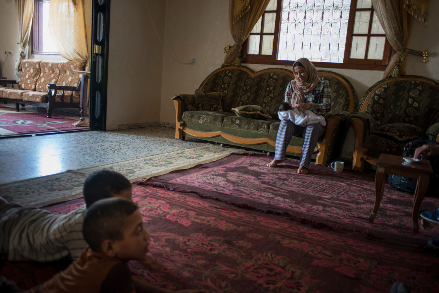 During heavy shelling in the southern city of Rafa, Marwan spends time with her niece, children and extended family who have been evacuated to her house. Three families are now living where one lived previously and there are 60 people in the building.