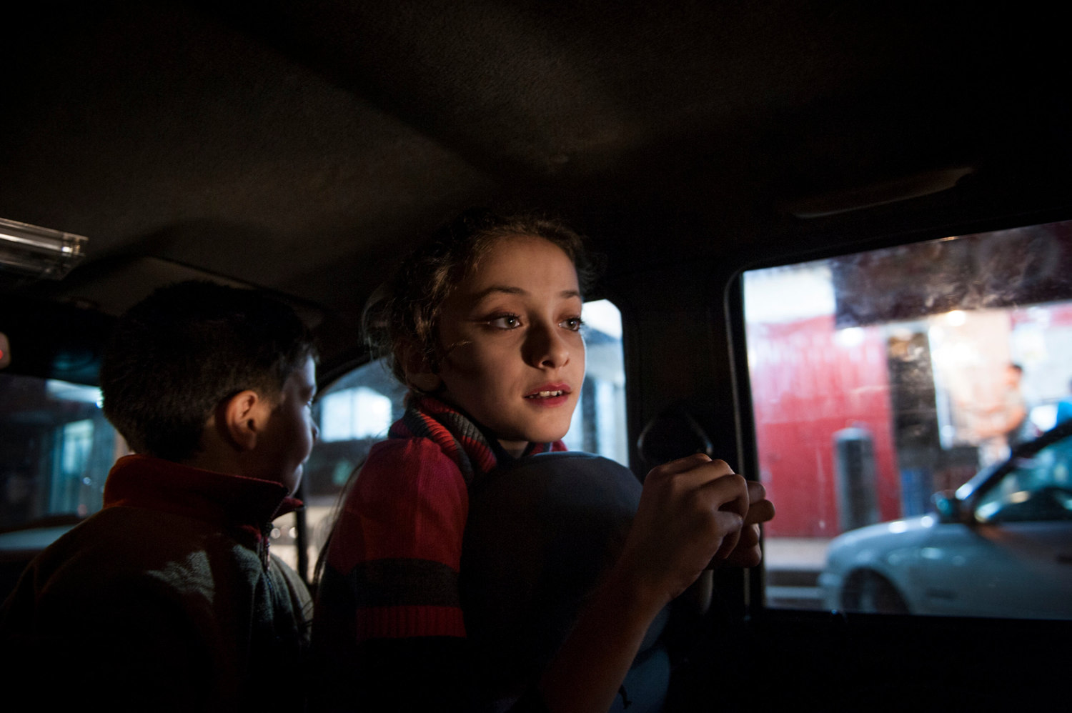 Yara and her brother waiting for their father to return with schwarma as an evening treat after a recent conflict ended.