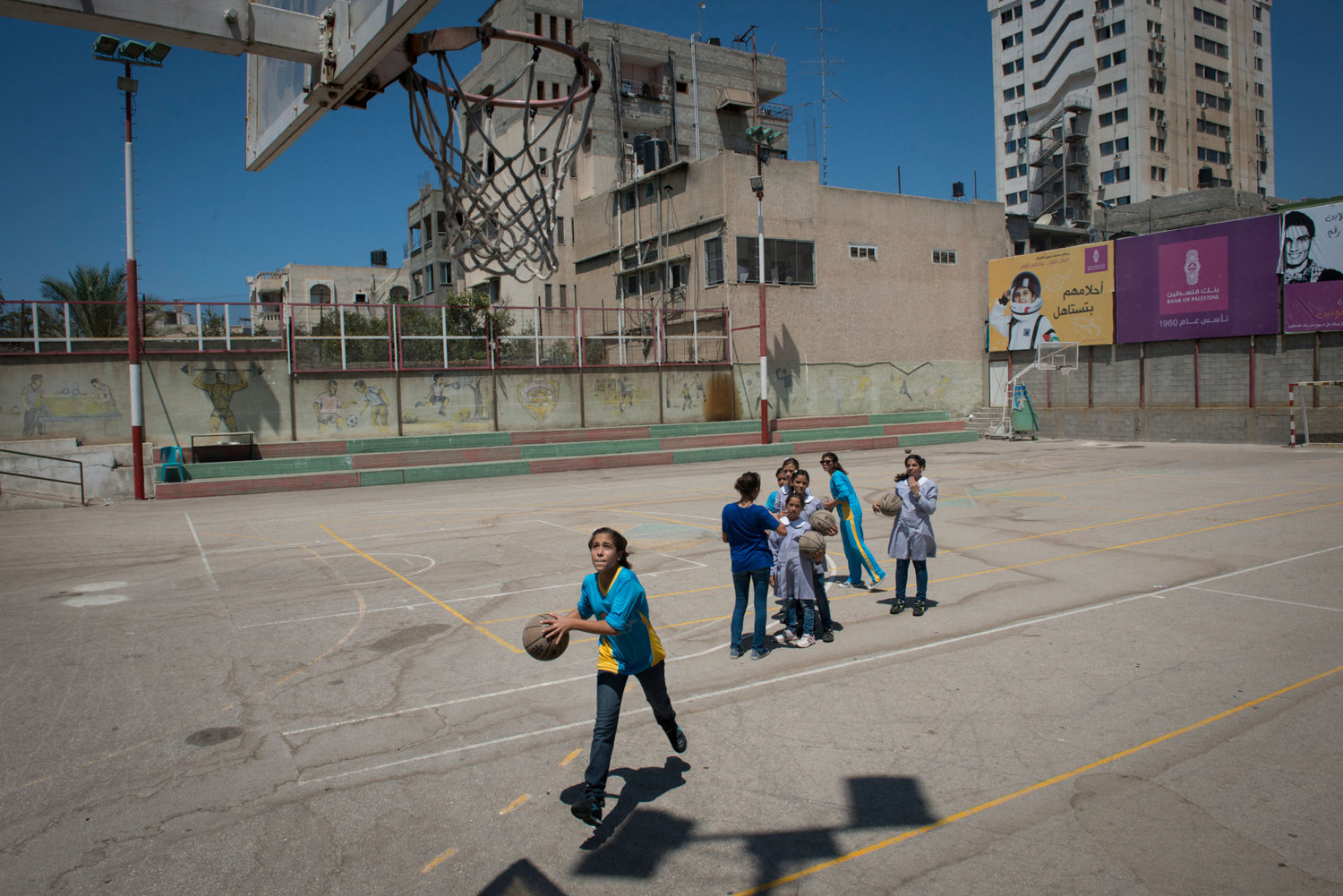 Girls play Basketball at the Gaza Athletic Club, one of the oldest sporting clubs  in the country. The practice is sponsored by PACES, a charity that works to get girls active. Women in Gaza typically do all types of sports till the age of 16, when family pressure forces them to stop as many families seek to find husbands for them.