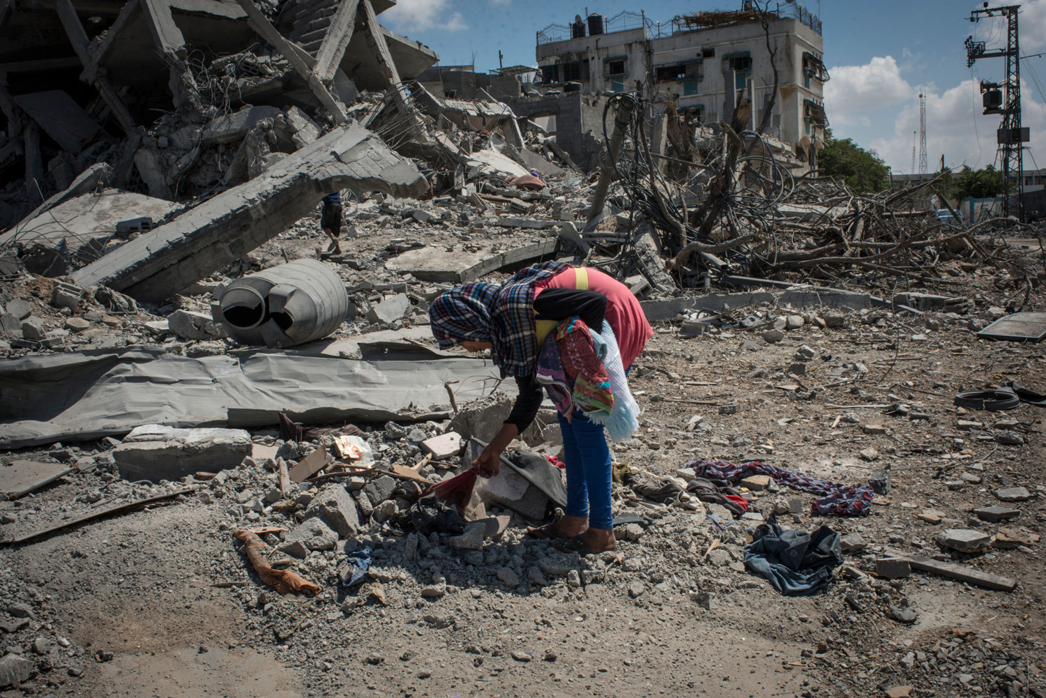 A girl picks through the rubble at what was previously her families home in Beit Hanoun, Gaza.
