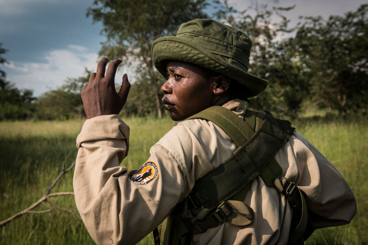 Rangers-in-Training during military style drills in the savannah. Patrols can last up to 6 hours in the scorching heat. Virunga's park guards responsibilities eclipse those of a typical park guard as the area is known to have incidents with local rebel groups.
