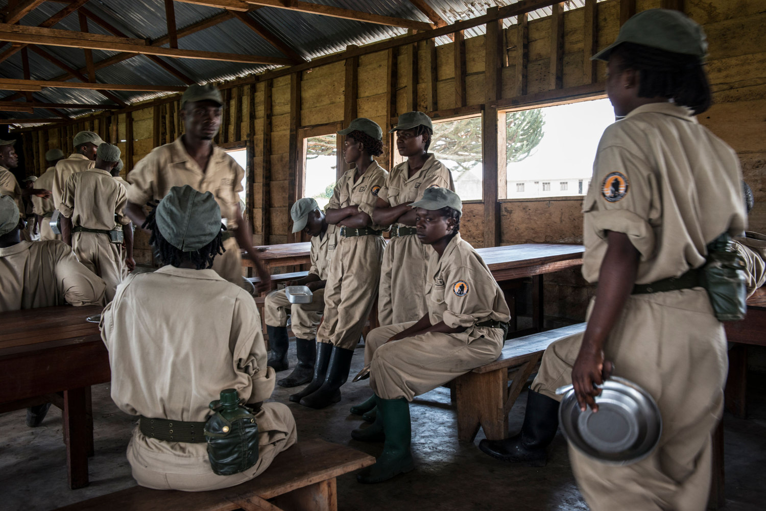Female rangers wait before being served their meal of rice and beans, which they receive up to two times a day.