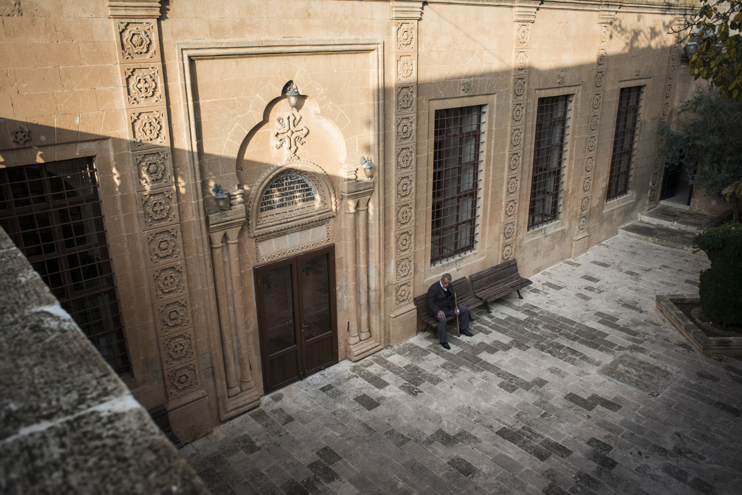 A man waits in the courtyard of Mor Barsaumo church on October 31th, 2014.