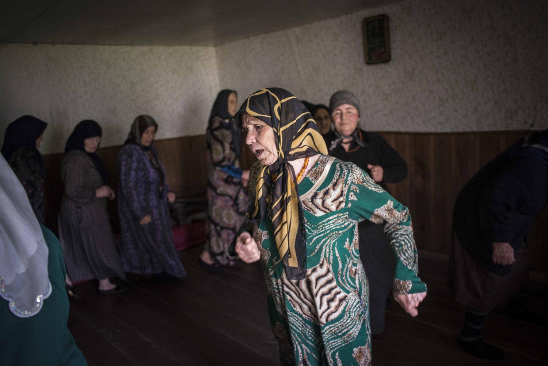 The women move in the prayer circle gradually gaining speed.