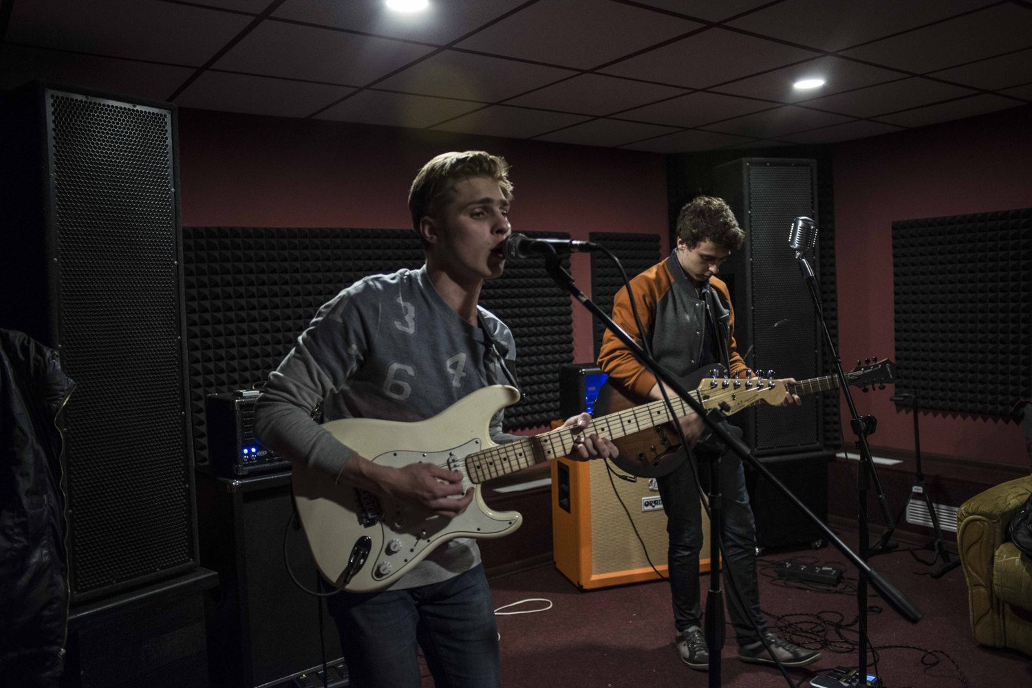 Danyl Bogdanerko, (left) 18 and Denys Rybchenko 17 play with their band Bonehouse in the suburbs of Kiev, Ukraine.