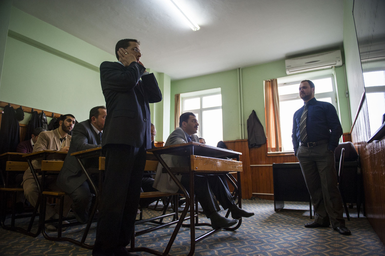 Fatıh Çağdaş demonstrates an azan for the class. Imams and other religions scholars attend Singing lessons held by the Beyoglu Müftülüğü in Istanbul Turkey. The lessons, taught by Fikret Yasin are held twice a week for an average of 20 scholars.