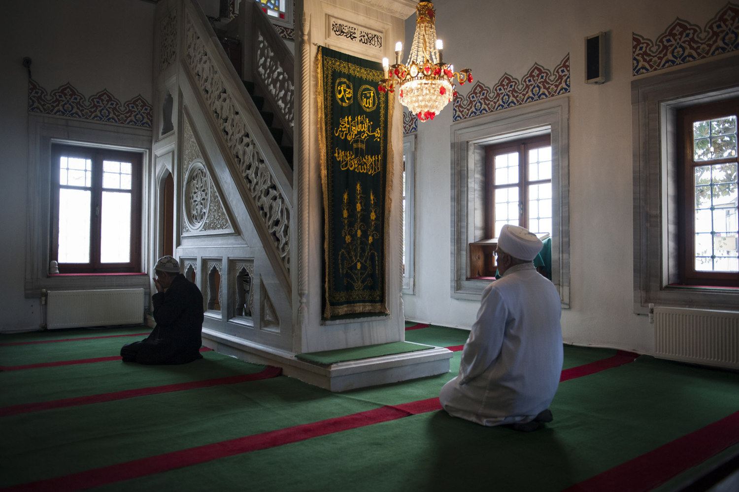 Imam Mehmet Ilhan sings a warm-up azan and then leads prayer at Ebul Fadil Mehmet Efendi Cami in Cihangir where he has been the Imam for over five years. Imams and other religions scholars attend singing lessons held by the Beyoglu Müftülüğü.