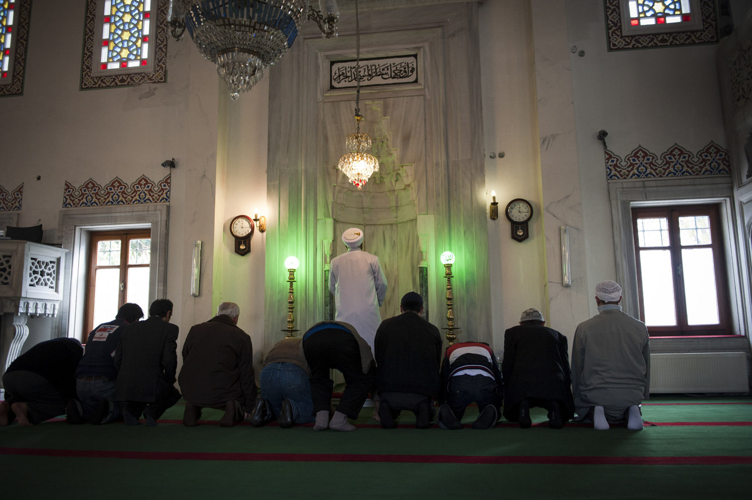 Imam Mehmet Ilhan sings a warm-up azan and then leads prayer at Ebul Fadil Mehmet Efendi Cami in Cihangir where he has been the Imam for over five years. Imams and other religions scholars attend singing lessons held by the Beyoglu Müftülüğü¸ in Istanbul Turkey.