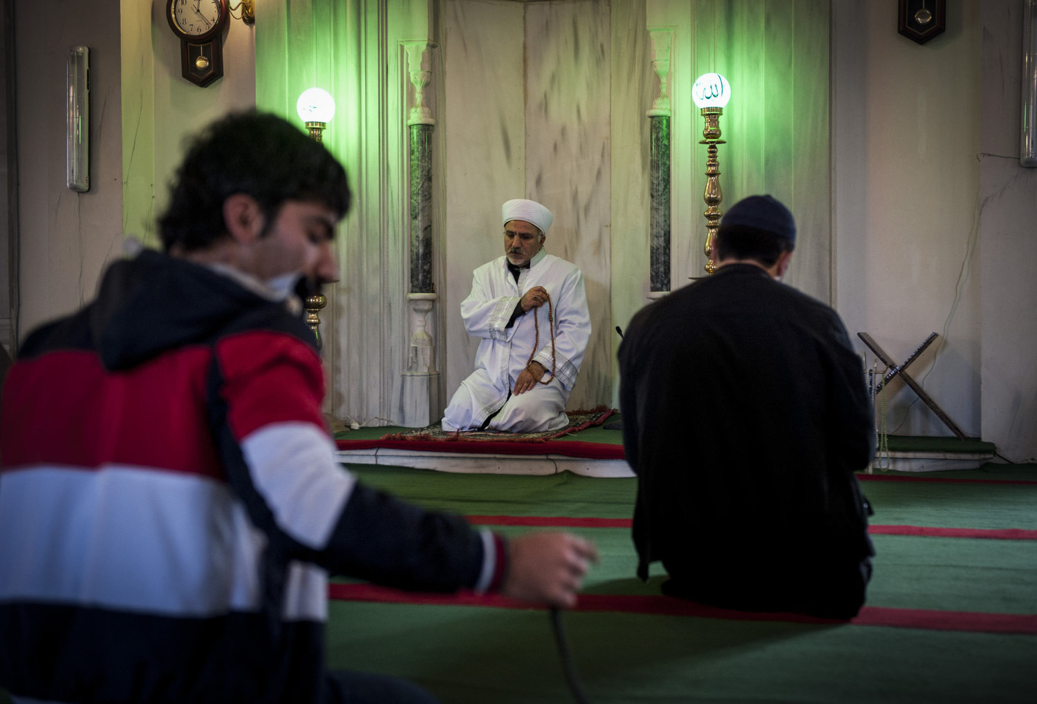 Imam Mehmet Ilhan leads prayer and sings Koranic verses at Ebul Fadil Mehmet Efendi Cami in Cihangir where he has been the Imam for over five years. While Ilhan's mosque broadcasts the Azan though a loudspeaker, many Imam's, including Ilhan find that learning the proper way to sing an Azan is helpful.