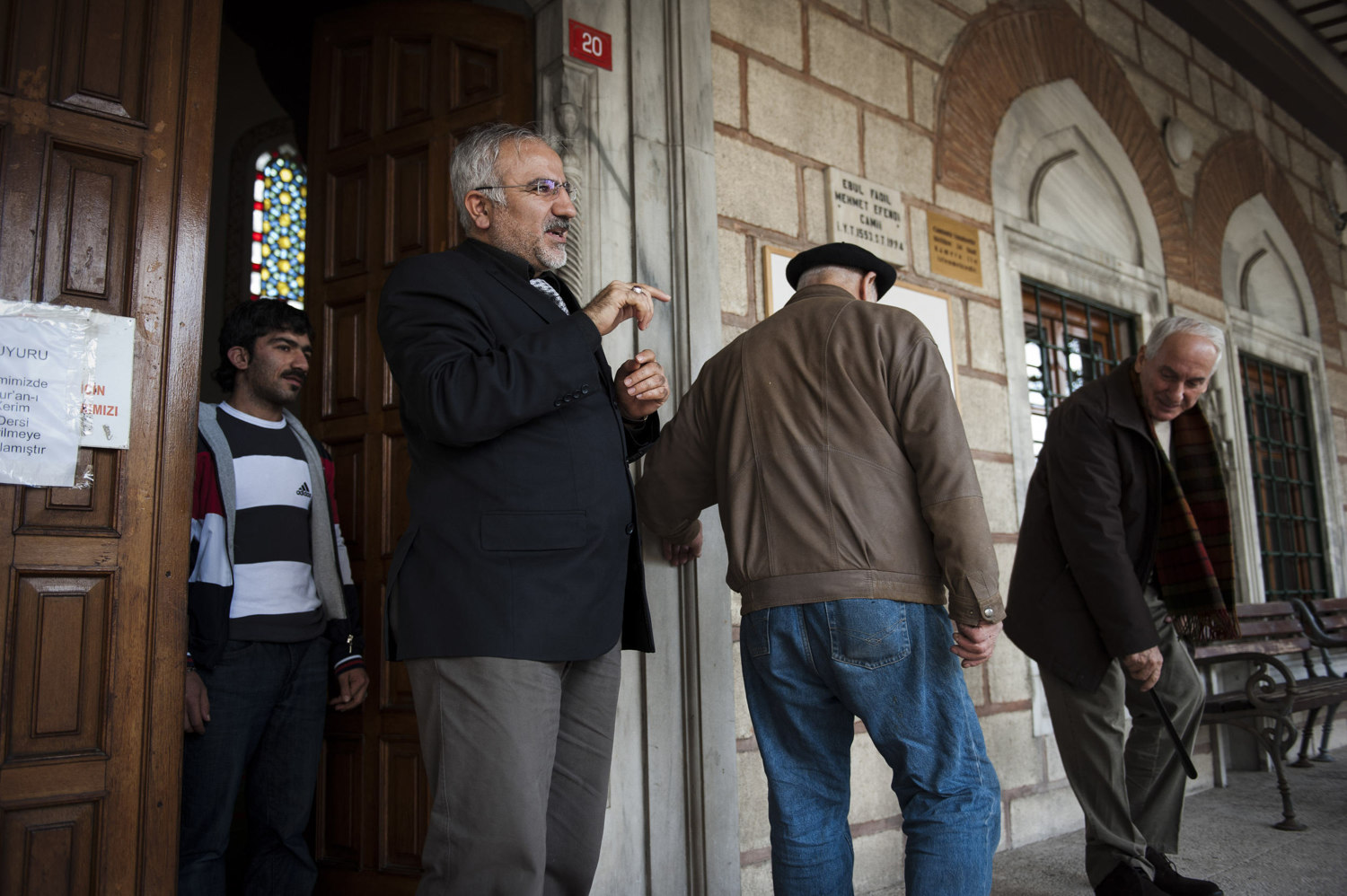 Imam Mehmet greets his worshipers after midday prayer at Ebul Fadil Mehmet Efendi Cami in Cihangir where he has been the Imam for over five years. Imams and other religions scholars attend singing lessons held by the Beyoglu Müftülüğü¸ in Istanbul Turkey.