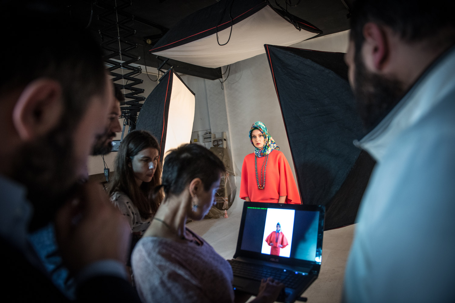 The photographer and editorial board of ALA magazine discuss an image that was an option for the cover. Scarves are pulled from a range of designers such as the domestic Armine to International brands such as Louis Vuitton and Hermes
