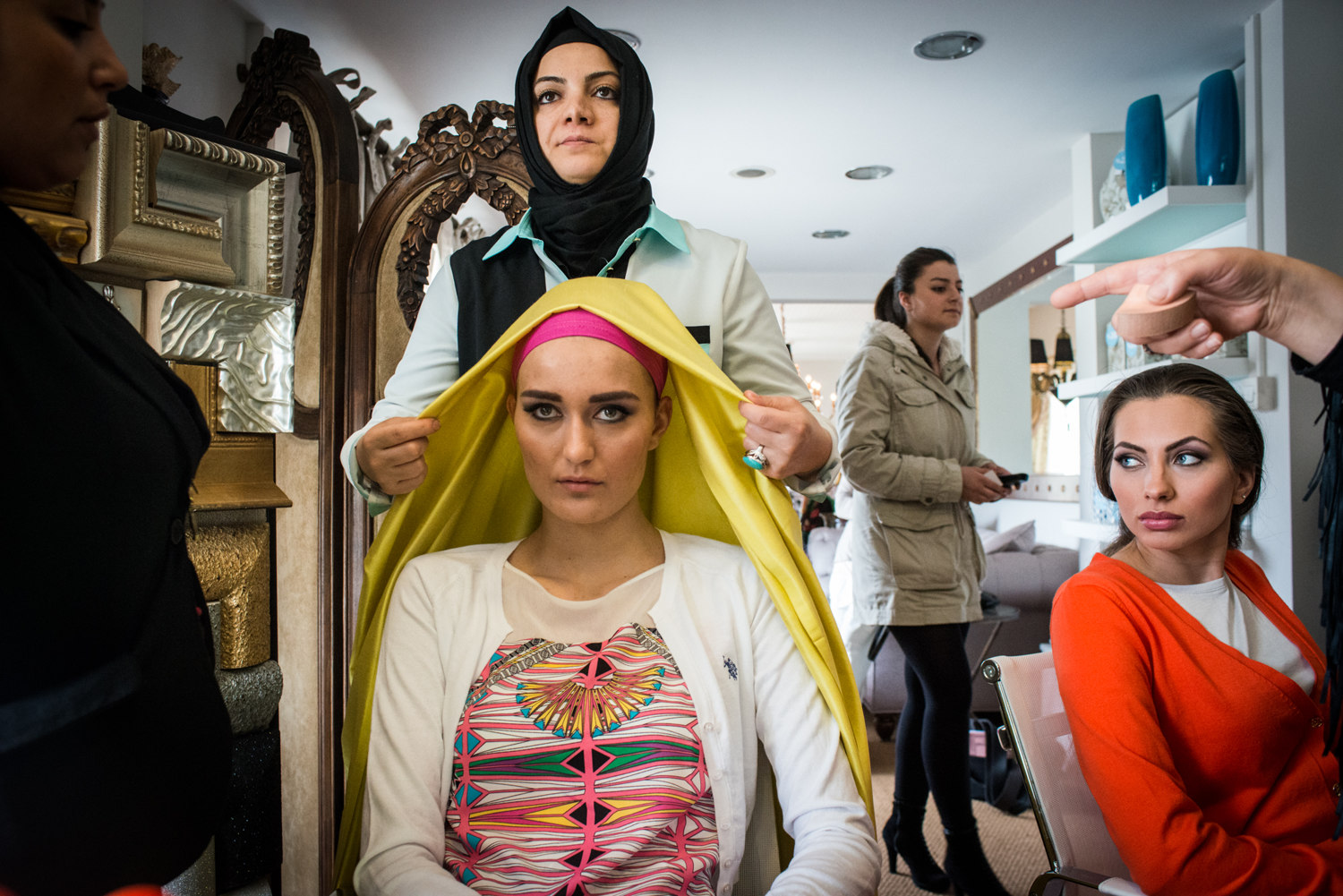 Models are made up before a shoot for ALA Magazine, the first magazine in Turkey for conservative women. Preparations include full make-up and headscarves- layered for a pop of color.