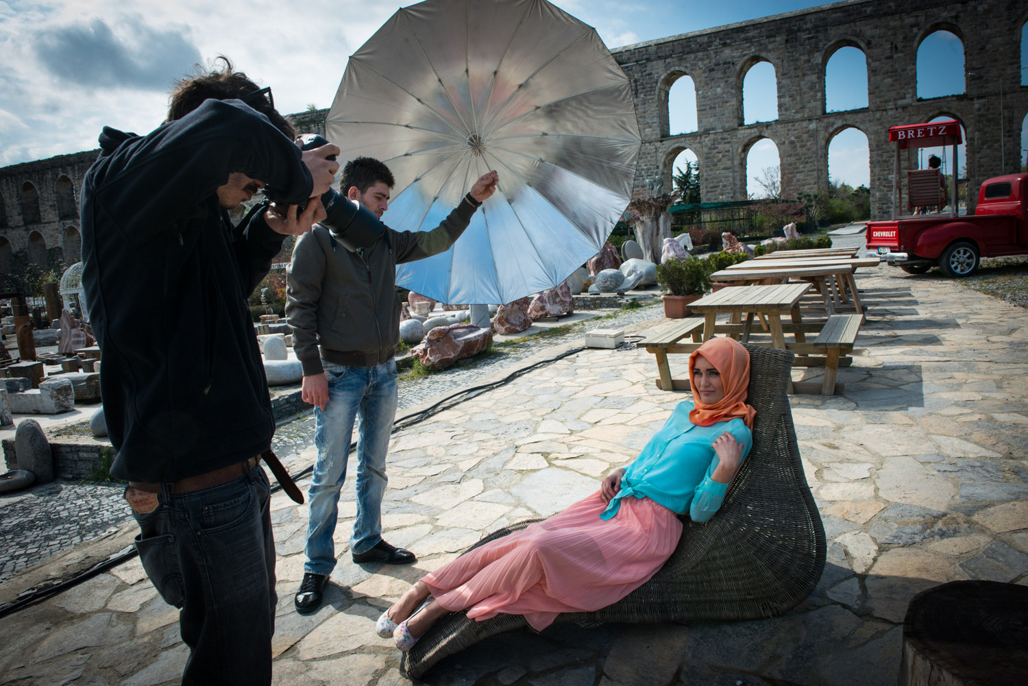 A model poses in front of the historic Aqueducts at a fashion shoot for ALA Magazine at Bretz Home in Kemerburgaz, Istanbul. Turkey