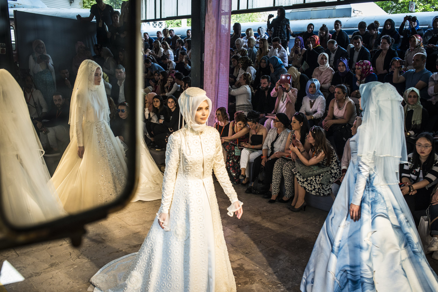 Runway shows at the first day of IMFW. Images from the first day of Modanisa's Istanbul Modest Fashion Week which takes place at Haydarpasa train station in Istanbul, Turkey on May 13th, 2016.
