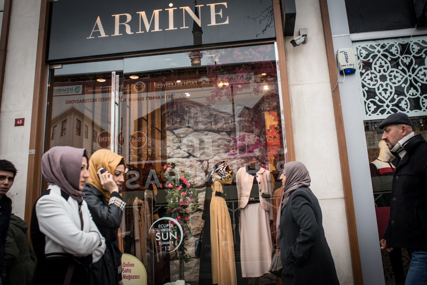 Shoppers walk past the Armine showroom. Armine- a high end Islamic fashion house rivals the designs of Hermes in the Middle East.