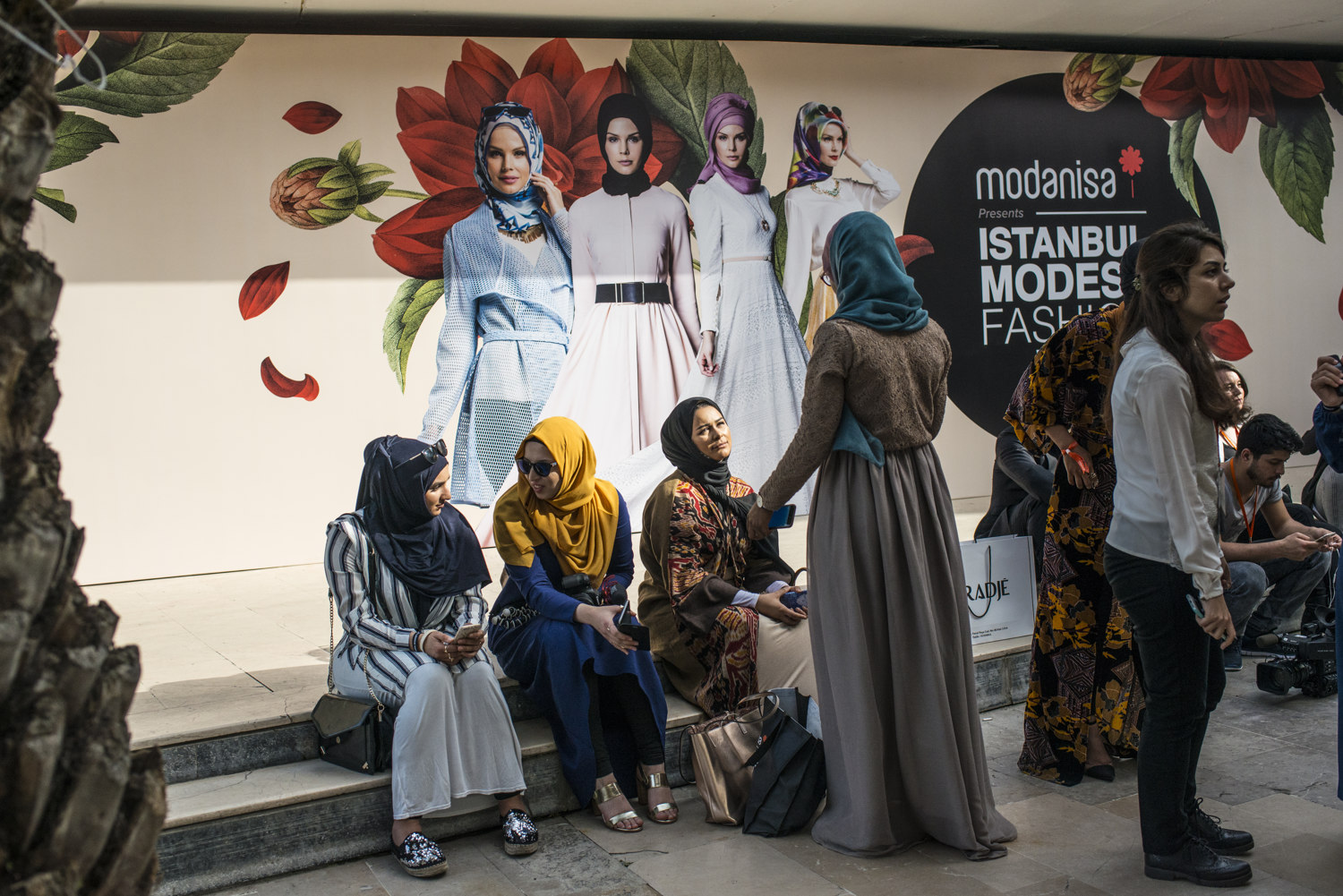 Women outside the shows at the first day of IMFW. Images from the first day of Modanisa's Istanbul Modest Fashion Week which takes place at Haydarpasa train station in Istanbul, Turkey on May 13th, 2016.