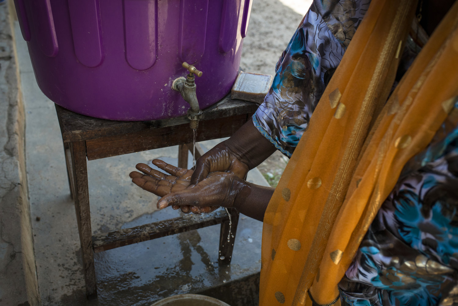 At a rural clinic patients as well as visitors must wash their hands in chlorinated water before entering the health post- the most rural of health clinics available in Guinea. This post is in Heriko, a village outside of Faranah, Guinea on November 19th, 2015.