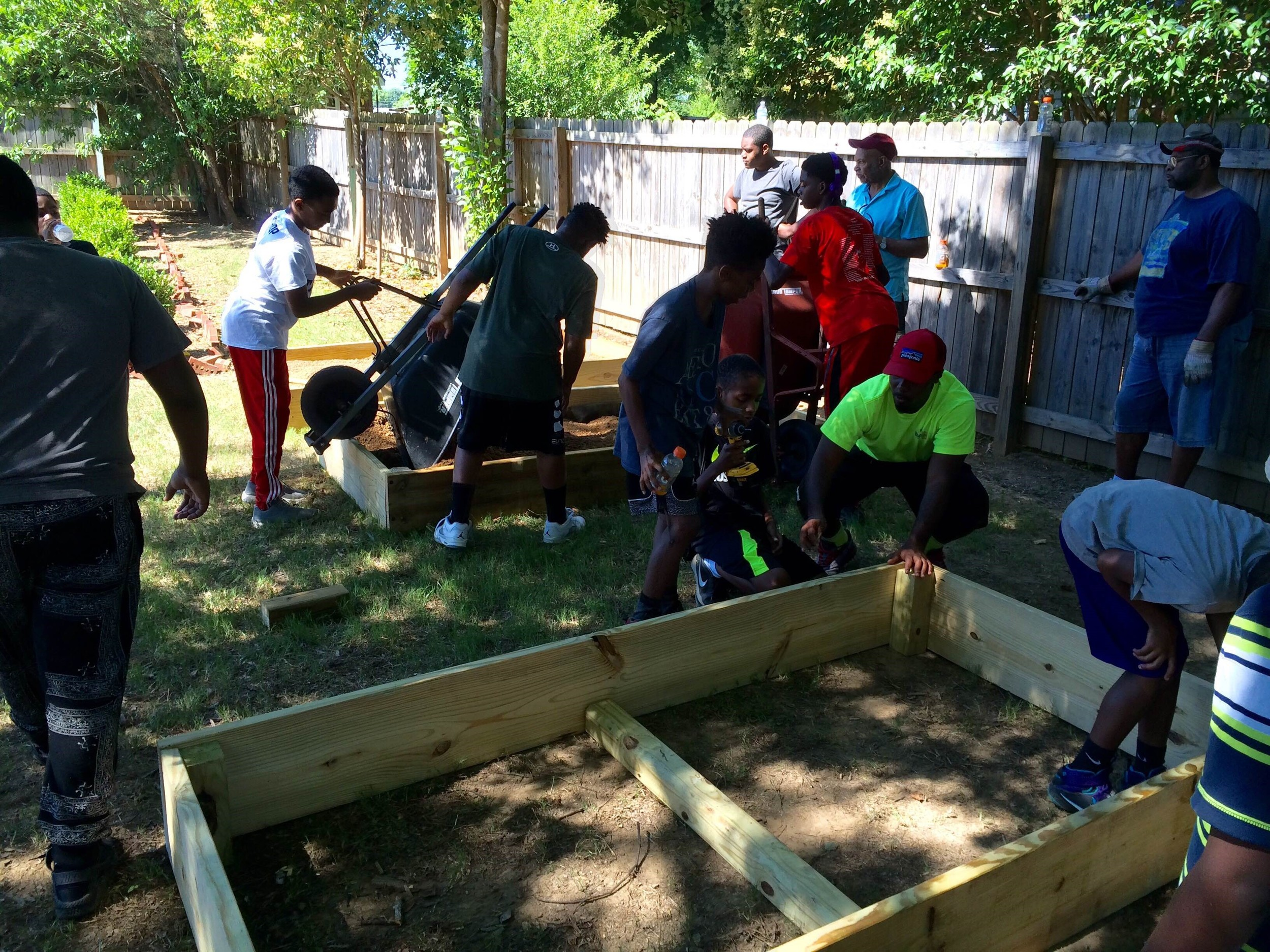 The participants in the Plum Grove program began building a community garden this week.
