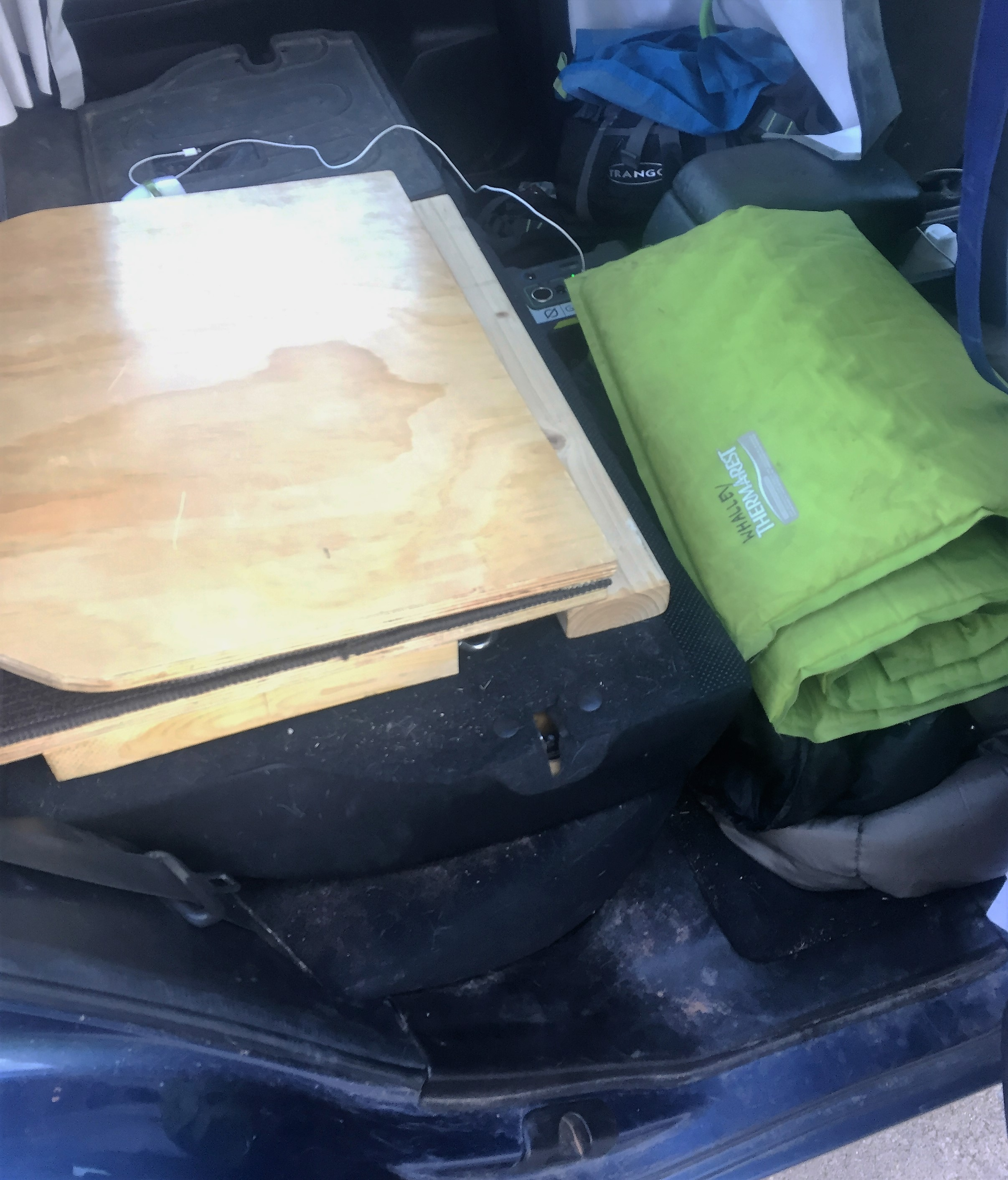 Platform folded up so front seat can slide back. Bed storage in footwell. I need to vacuum.