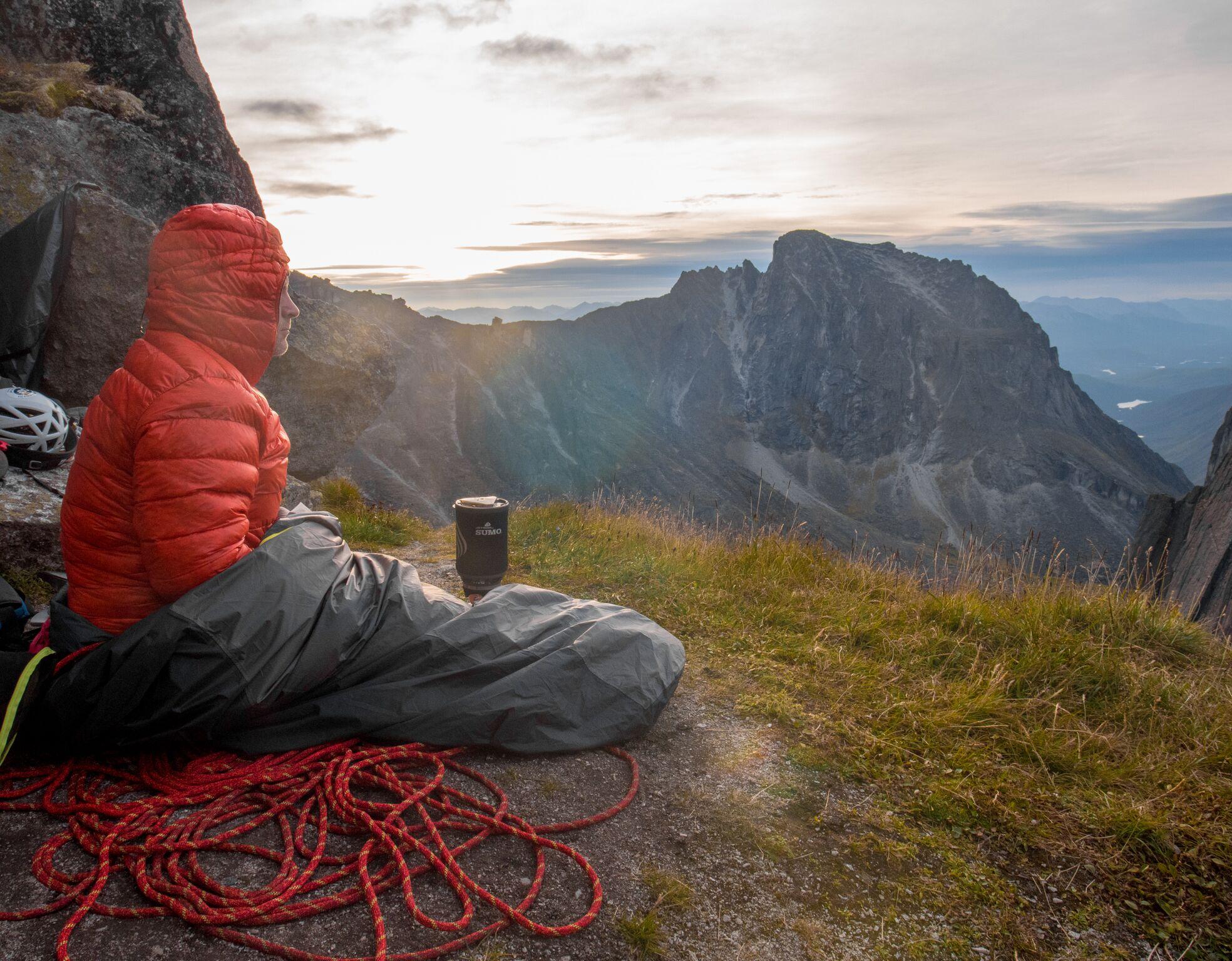 Jim enjoying breakfast on the bivy ledge. PC: Taylor Zann