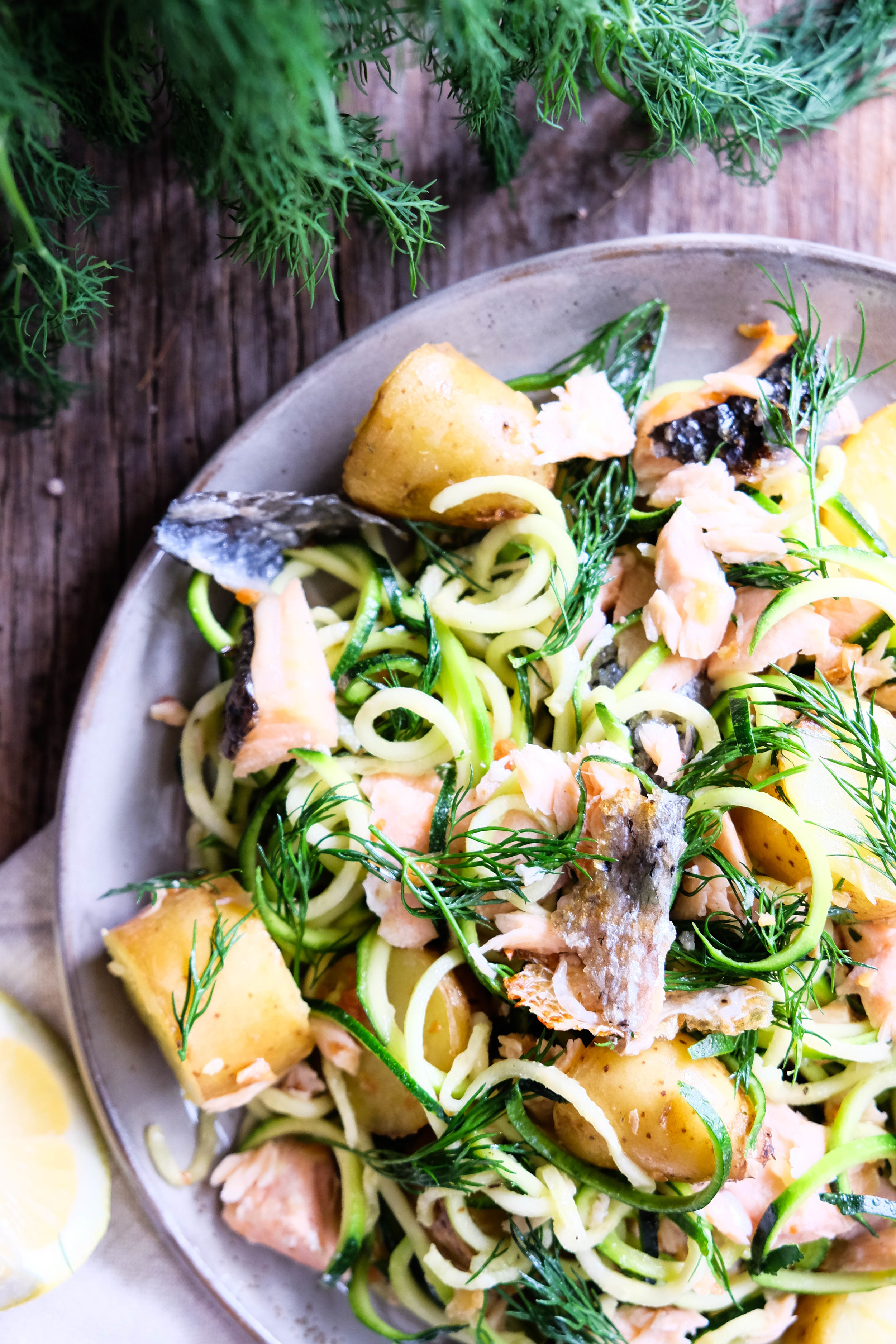 Warm salmon and potato salad with zoodles
