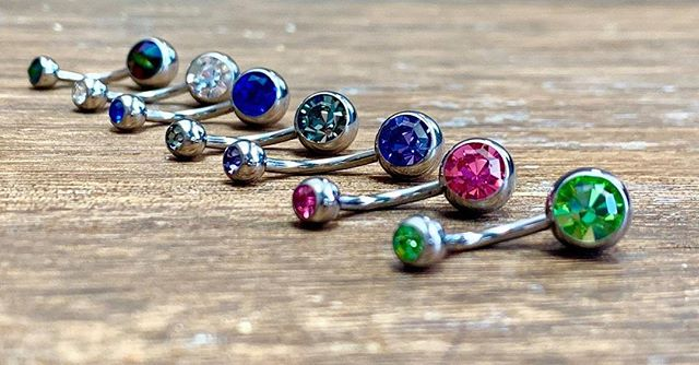 We have a beautiful assortment of jewelry! Check out these sparkling swarovski gems in our titanium curved barbells for new or healed navel piercings. Stop by and get yourself something pretty today, we have walk-in piercing from 1pm-8pm!