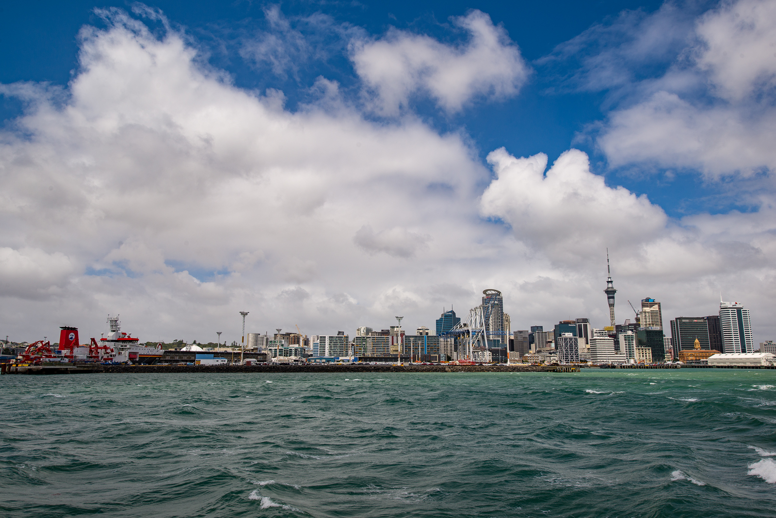 The skyline of Auckland with RV Sonne in the foreground as seen from the Rangitoto ferry.