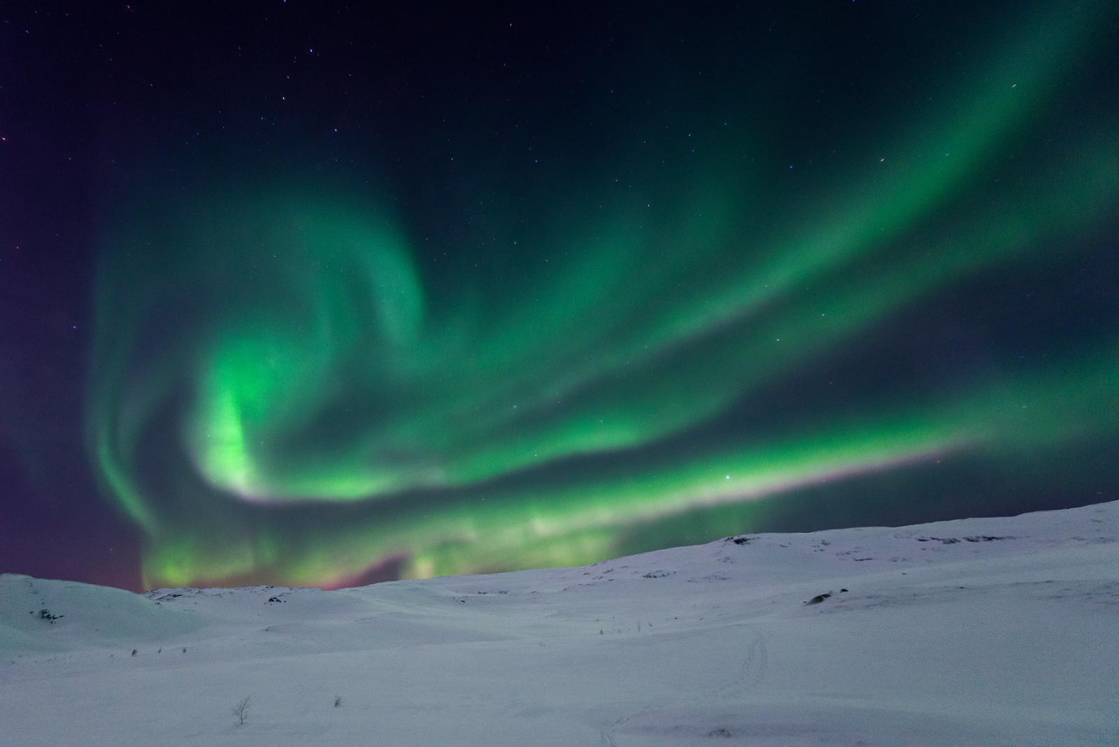 Swirling polar lights at night.