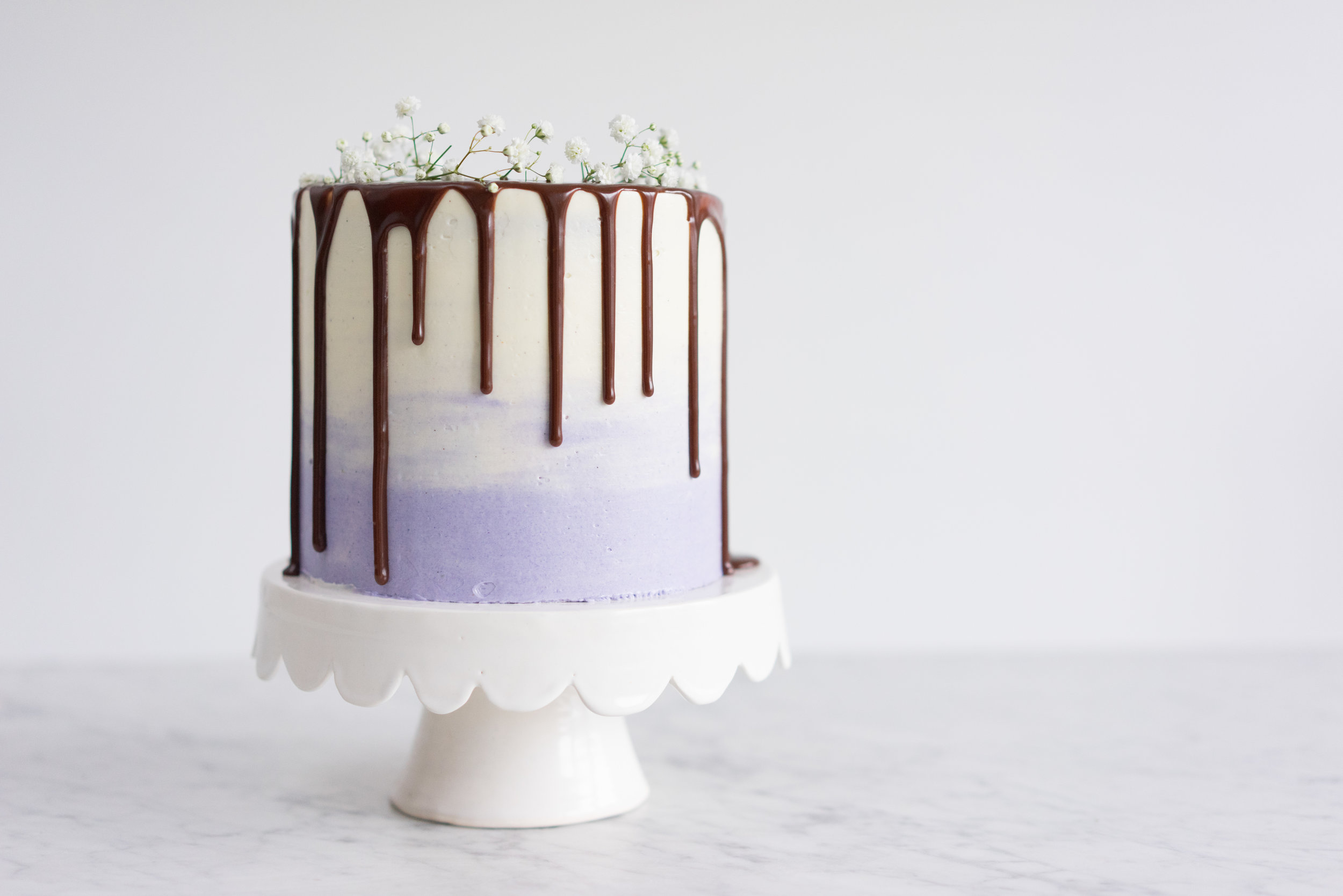 Honey lavender cake with vanilla german buttercream and lavender milk chocolate ganache drip